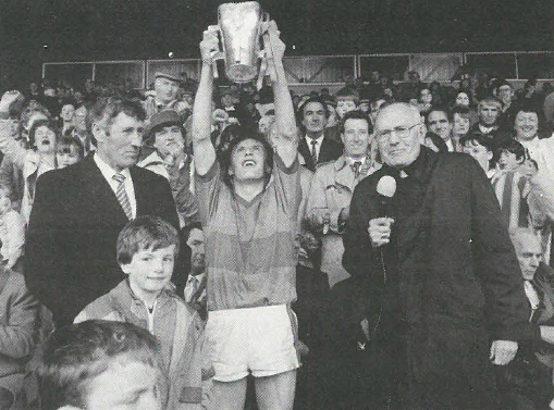 Loughmore Castleiney captain Eamon Sweeney lifts the Dan Breen Cup following this teams victory in the County Final