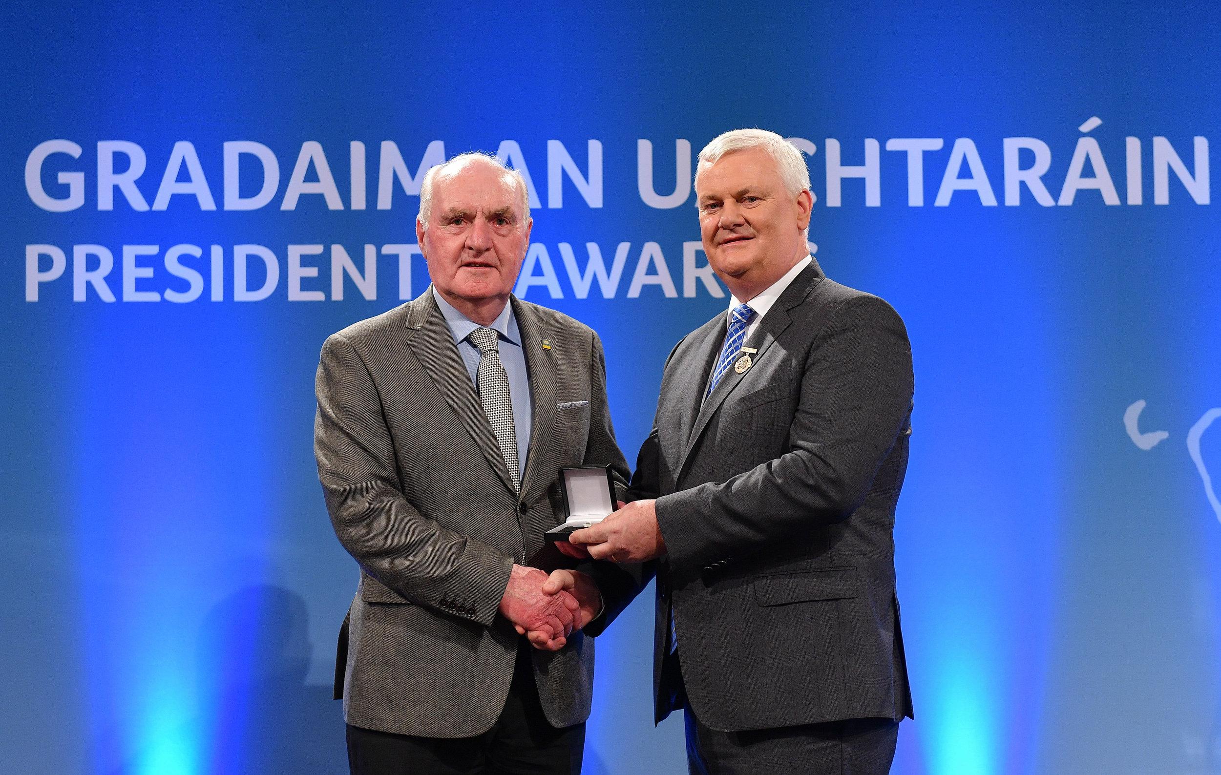 Seamus J. King receives a GAA President's Award from Uachtaran Aogán Ó Fearghail
