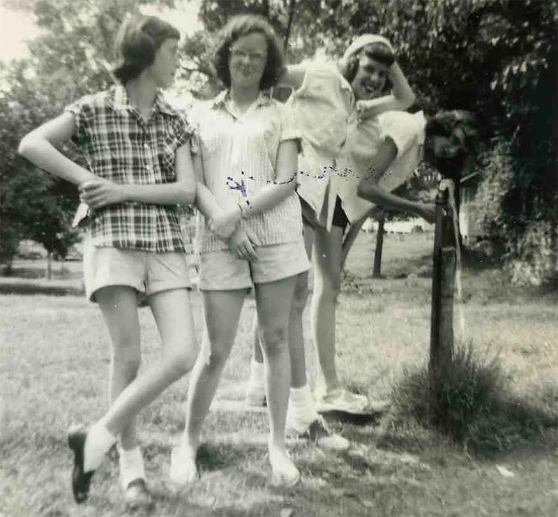 Four girls posing for a photo at Summer Camp - NaCoMe Christian Camp History