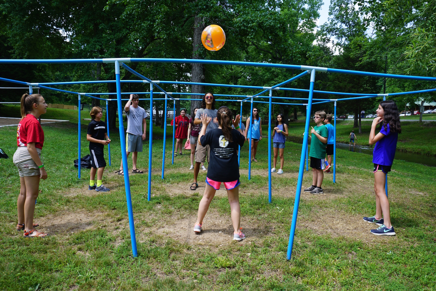 Young pre-teen girls playing a game with a ball at Summer Camp - NaCoMe Camp & Conference Center