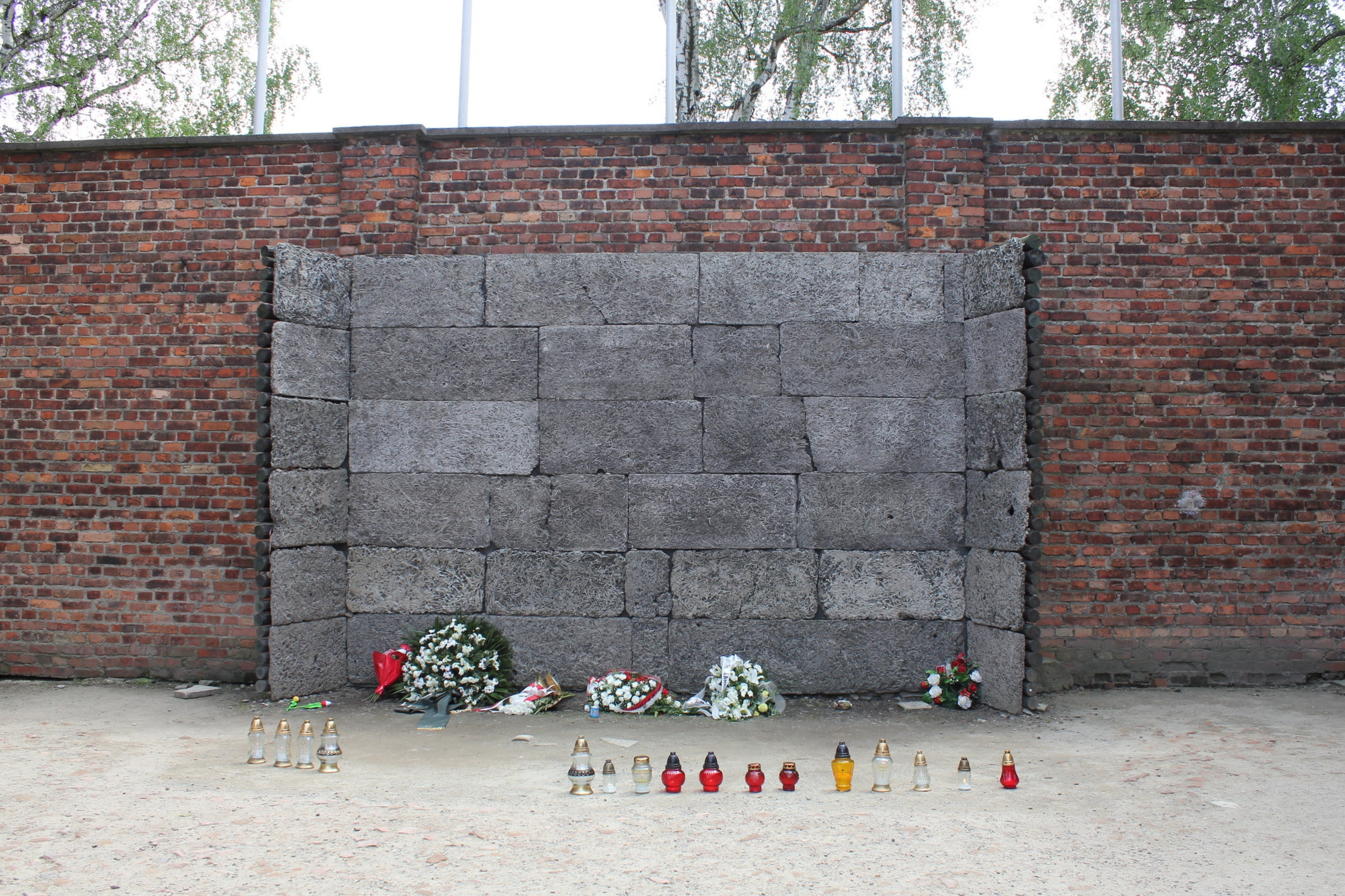 """The infamous """"death wall"""" at the notorious Block 11 of Auschwitz I, where thousands of prisoners were executed"""