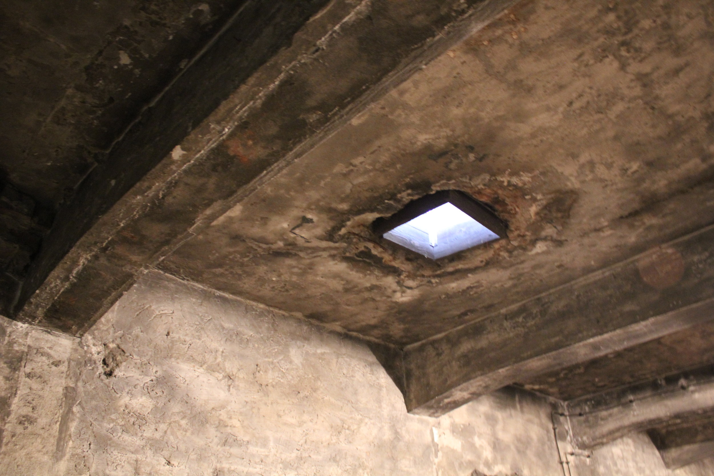 The hatch in Krema I through which canisters of Zyklon B were dropped