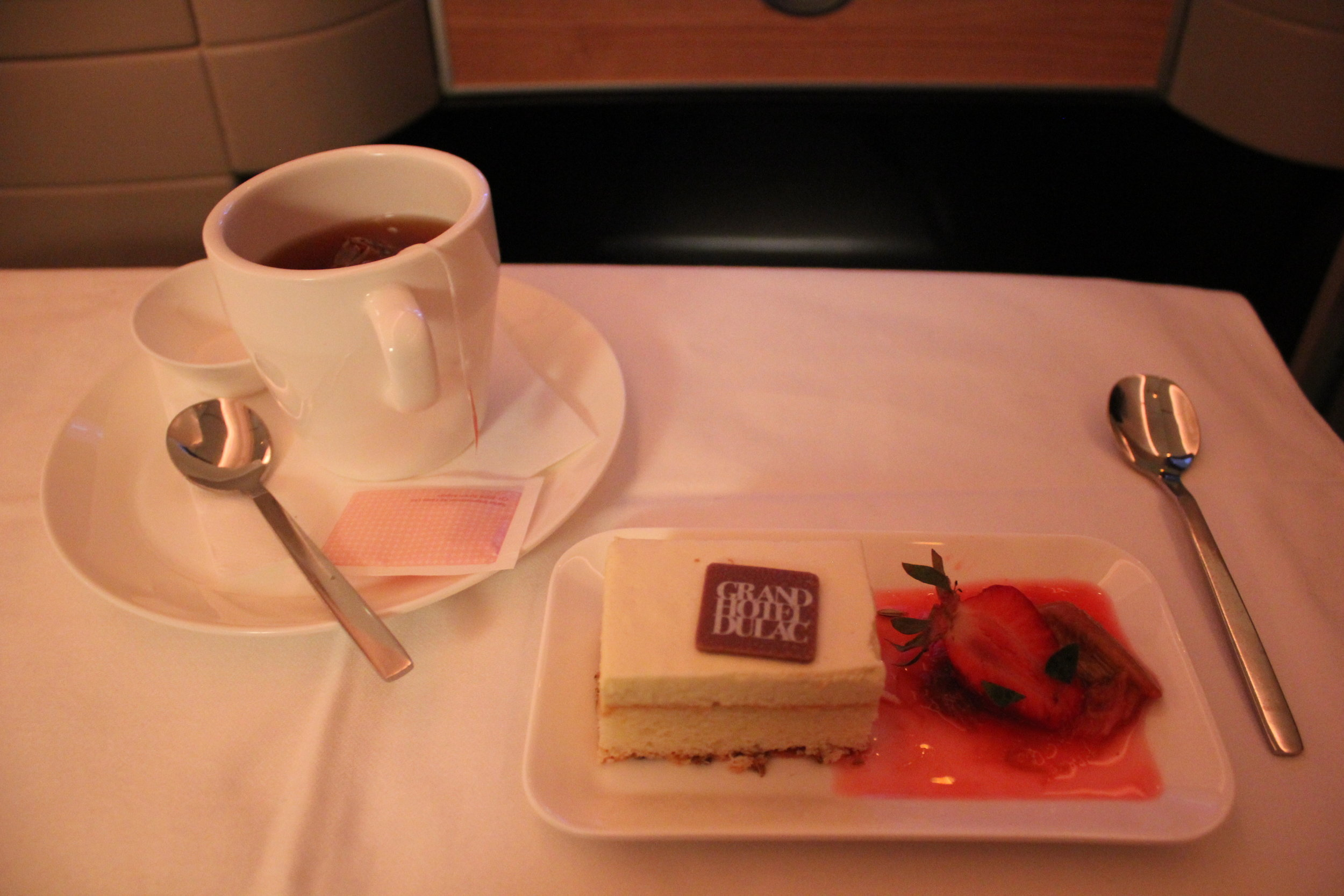 Swiss 777 business class – Financier cake with strawberry and rhubarb compote