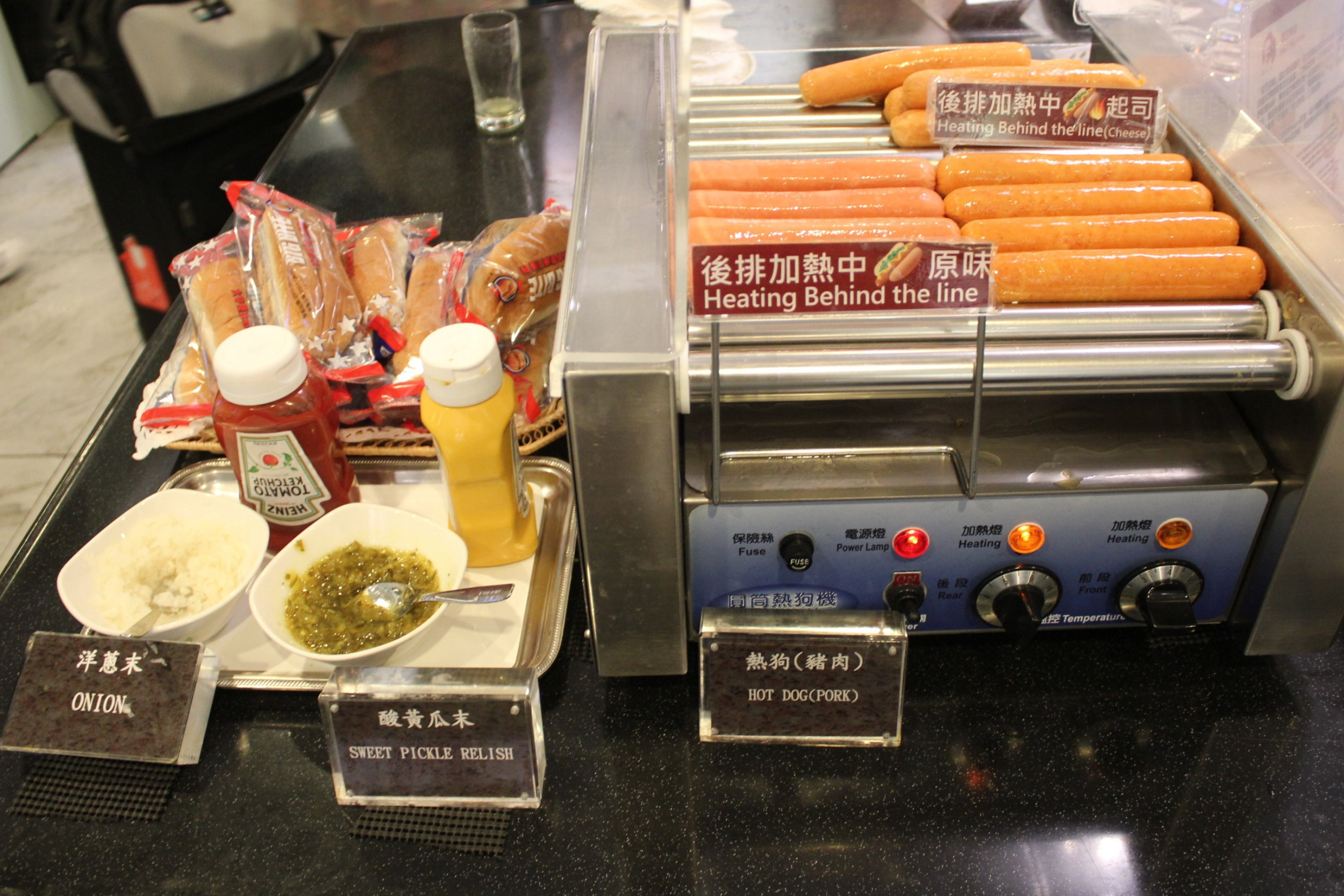 The Infinity Lounge by EVA Air – Hot dog roller