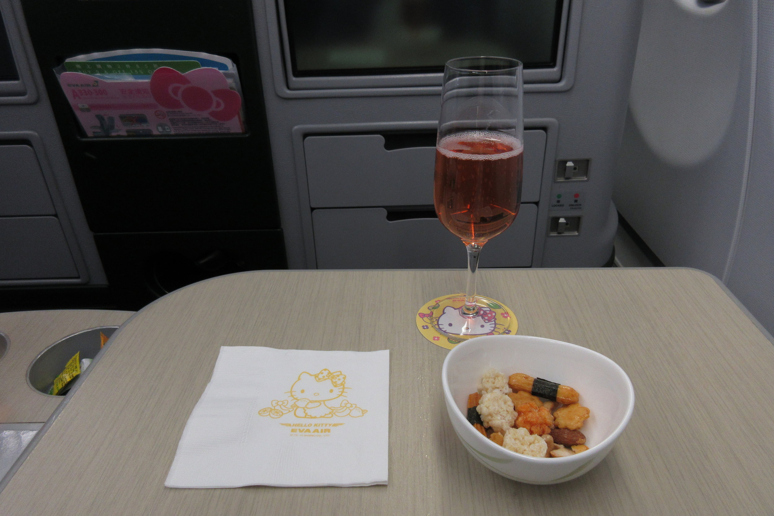 EVA Air regional business class – Mixed snacks and champagne