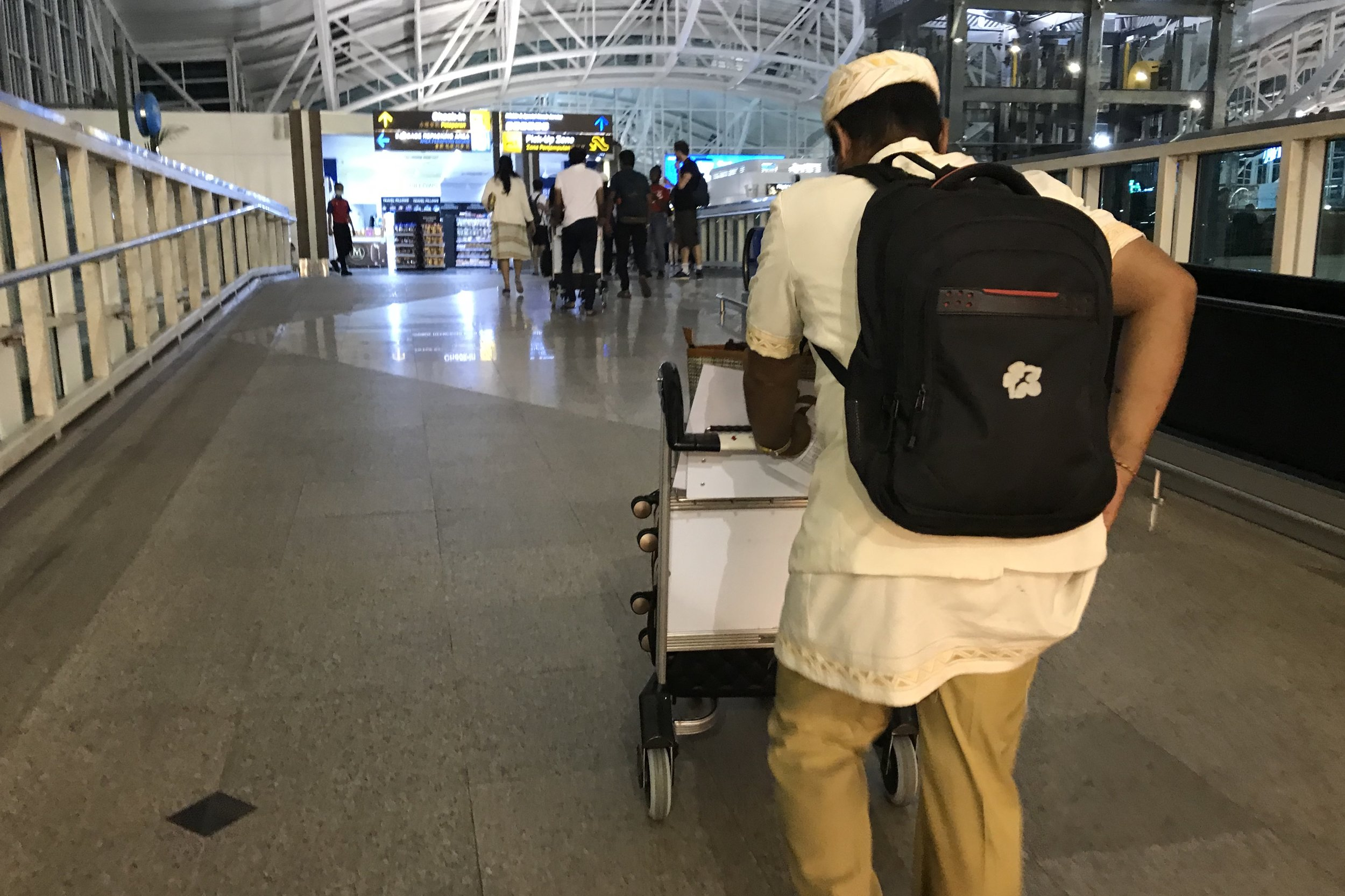 St. Regis Bali – Associate helping us with bags