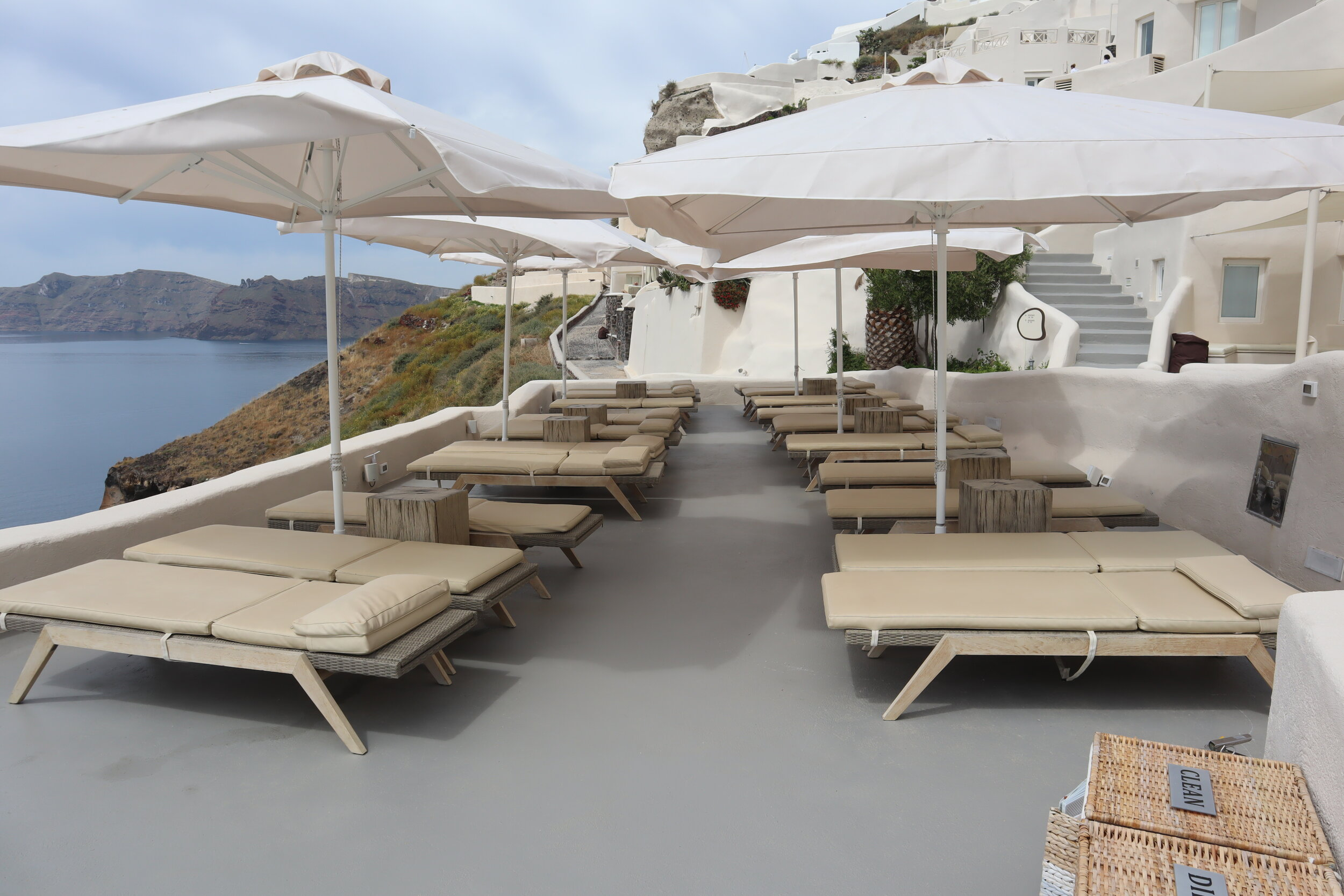 Mystique Santorini – Poolside lounge chairs