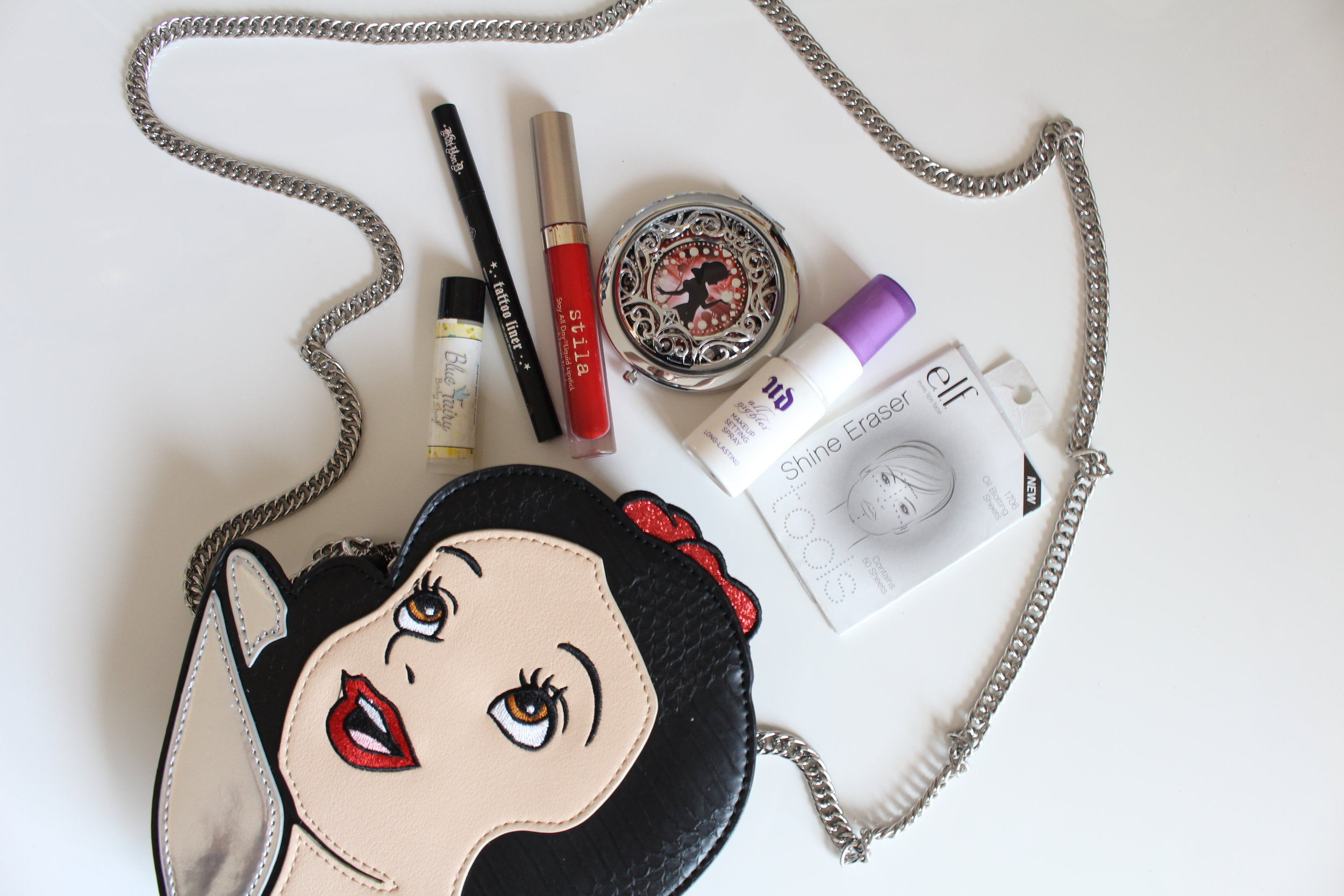 Snow White Purse is from Danielle Nicole Handbags, available   here    Snow White Compact mirror was limited edition from Sephora and is unfortunately no longer sold. :(