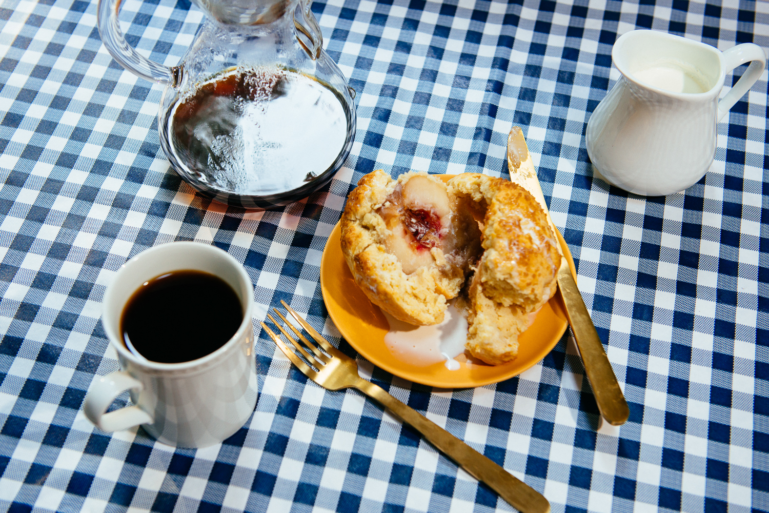 White peaches inside a biscuit with heavy cream.