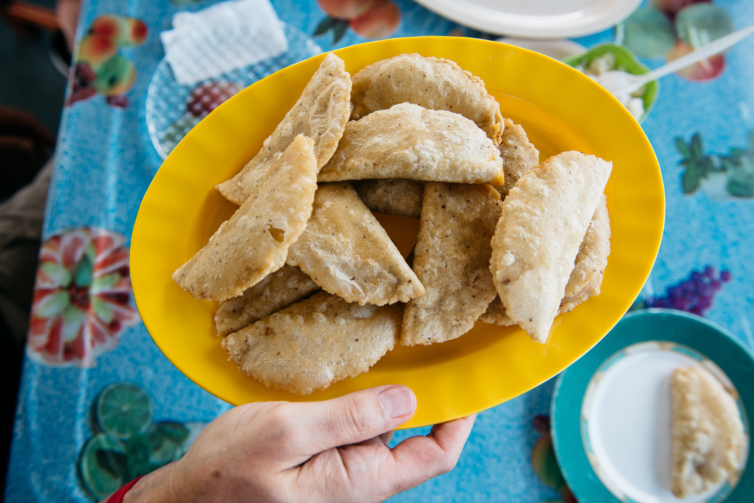 Panades: A fried Belizean hand pie filled with recado-spiced meat and eaten with cabbage