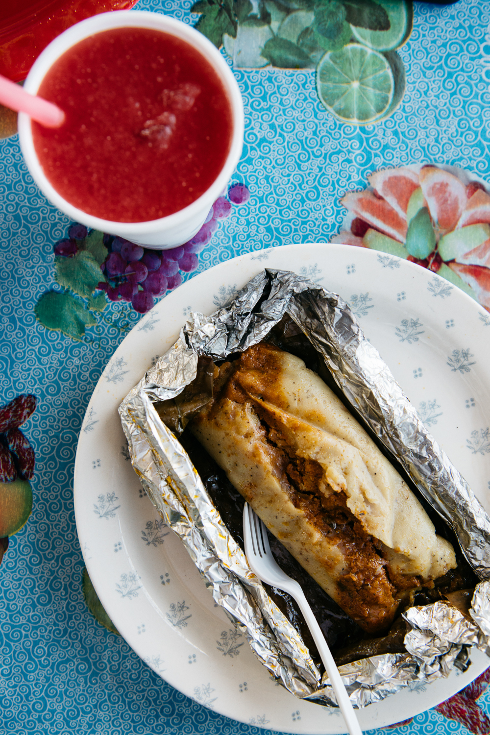 Belizean Tamale: masa that is stuffed with recado-spiced pork or chicken and steamed inside a banana leaf
