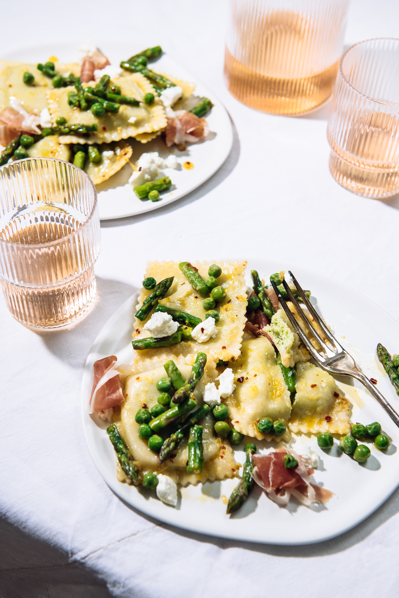 goat cheese ravioli with spring vegetables and rose wine