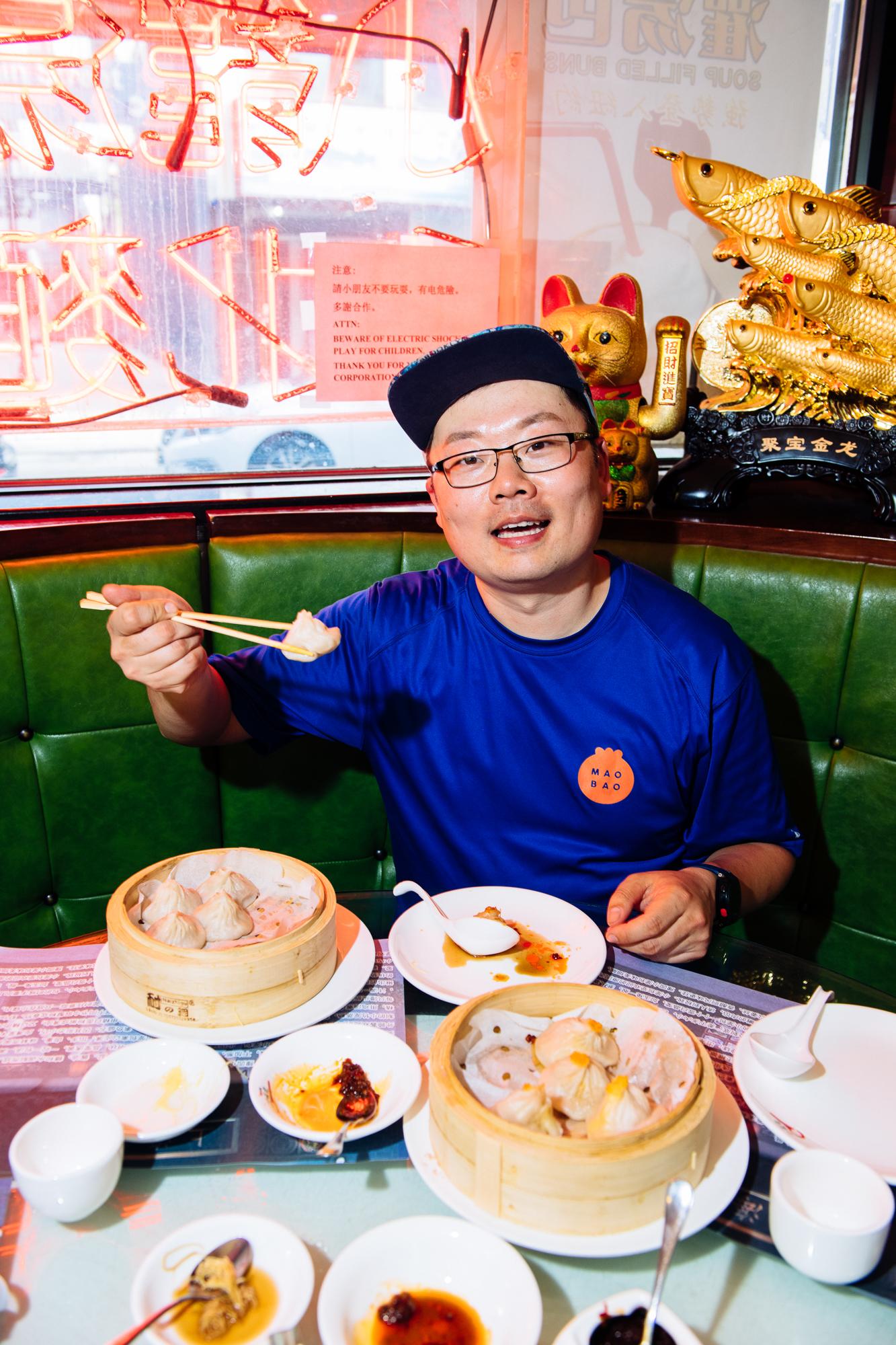 Eddie and xiao long bao (soup dumplings) at Shanghai You Garden Dumpling in Flushing, Queens