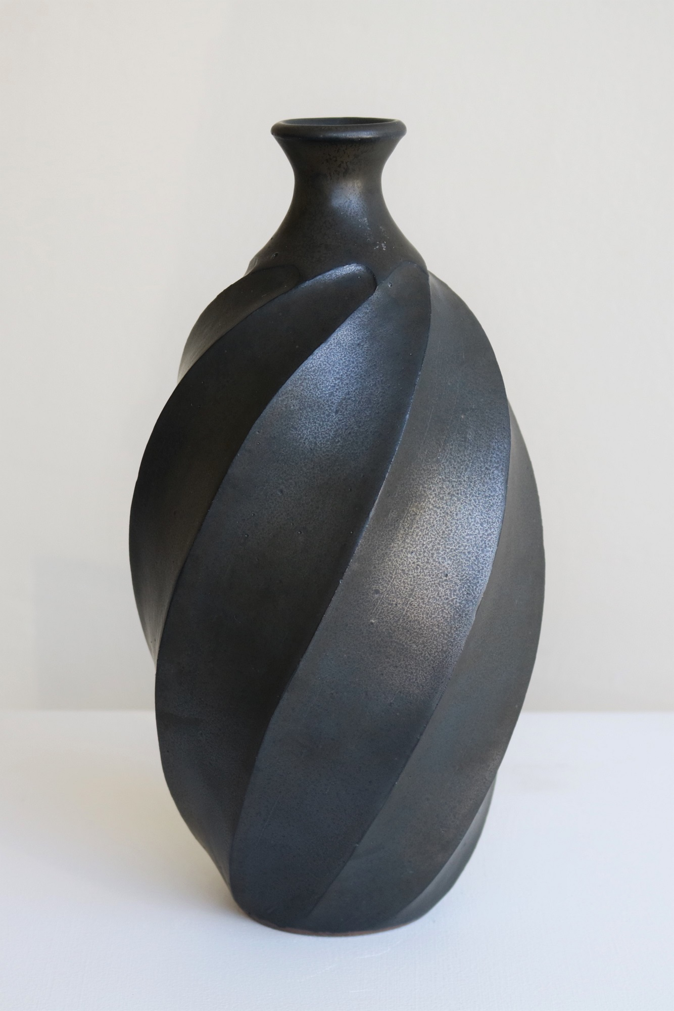 Terunobu Hirata,  Twist Facetted Bottle,  stoneware, black matt glaze, H26.5cm, 2017 AVAILABLE