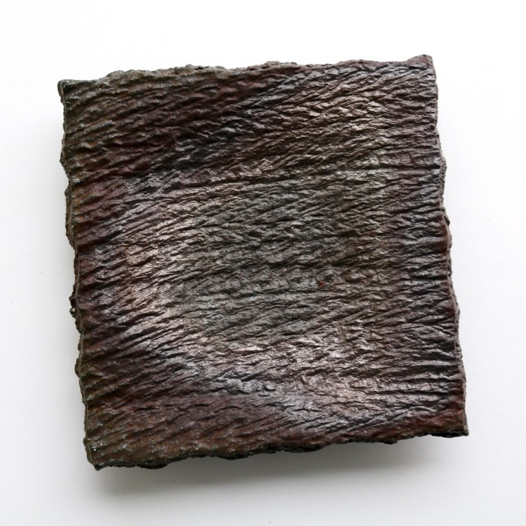 Yuri Wiedenhofer, 56.  Square Shallow Plate,    2018, impressed Cuttagee high iron clay, 5.5 day wood firing, Yellow Stringy to start, Black Wattle and Hickory, Melaleuca to finish, Pittosporum undulata (green) final stoke