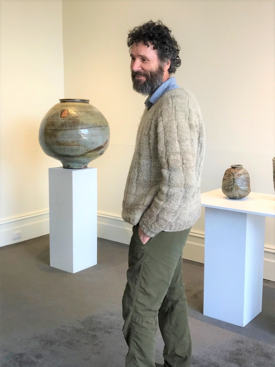 Kirk Winter & Yuri Wiedenhofer Exhibition Opening, June 2018. Yuri with Kirk's works in the background.