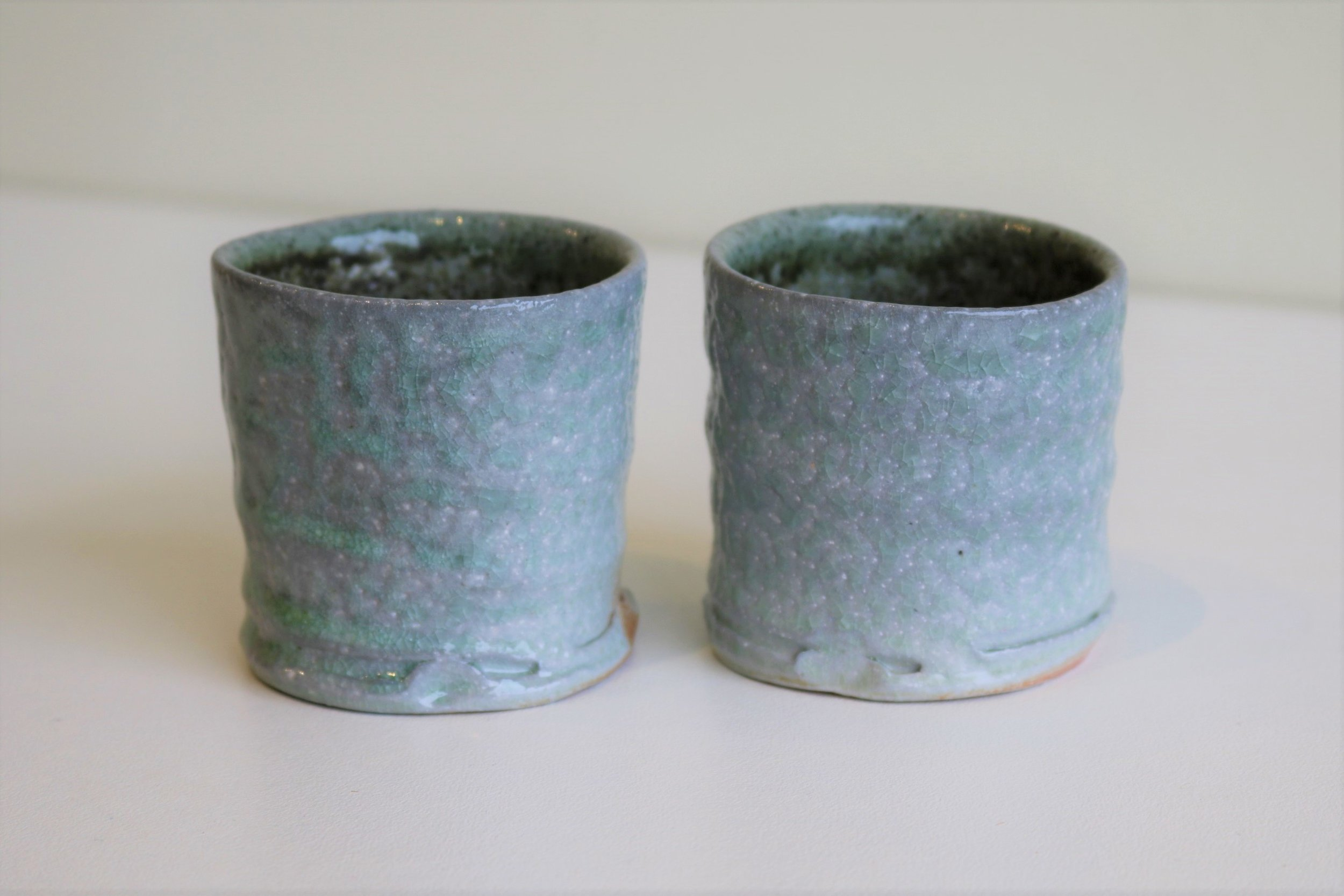 Yuri Wiedenhofer, 48.  Beakers,  2018, recycled porcelain, Tanja syenite interior glaze, carbon trapping, 5.5 day wood firing, Yellow Stringy to start, Black Wattle and Hickory, Melaleuca to finish, Pittosporum undulata (green) final stoke