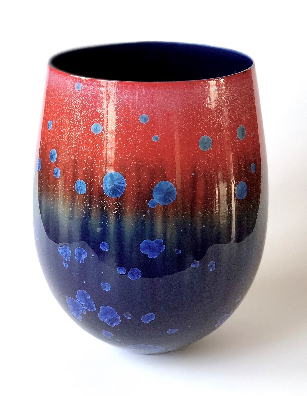 Ted Secombe 29.  Pod Bowl - Kimberley Sunrise , 2018, porcelain, gloss crystalline cobalt blue and red glazes, H32 x W23cm