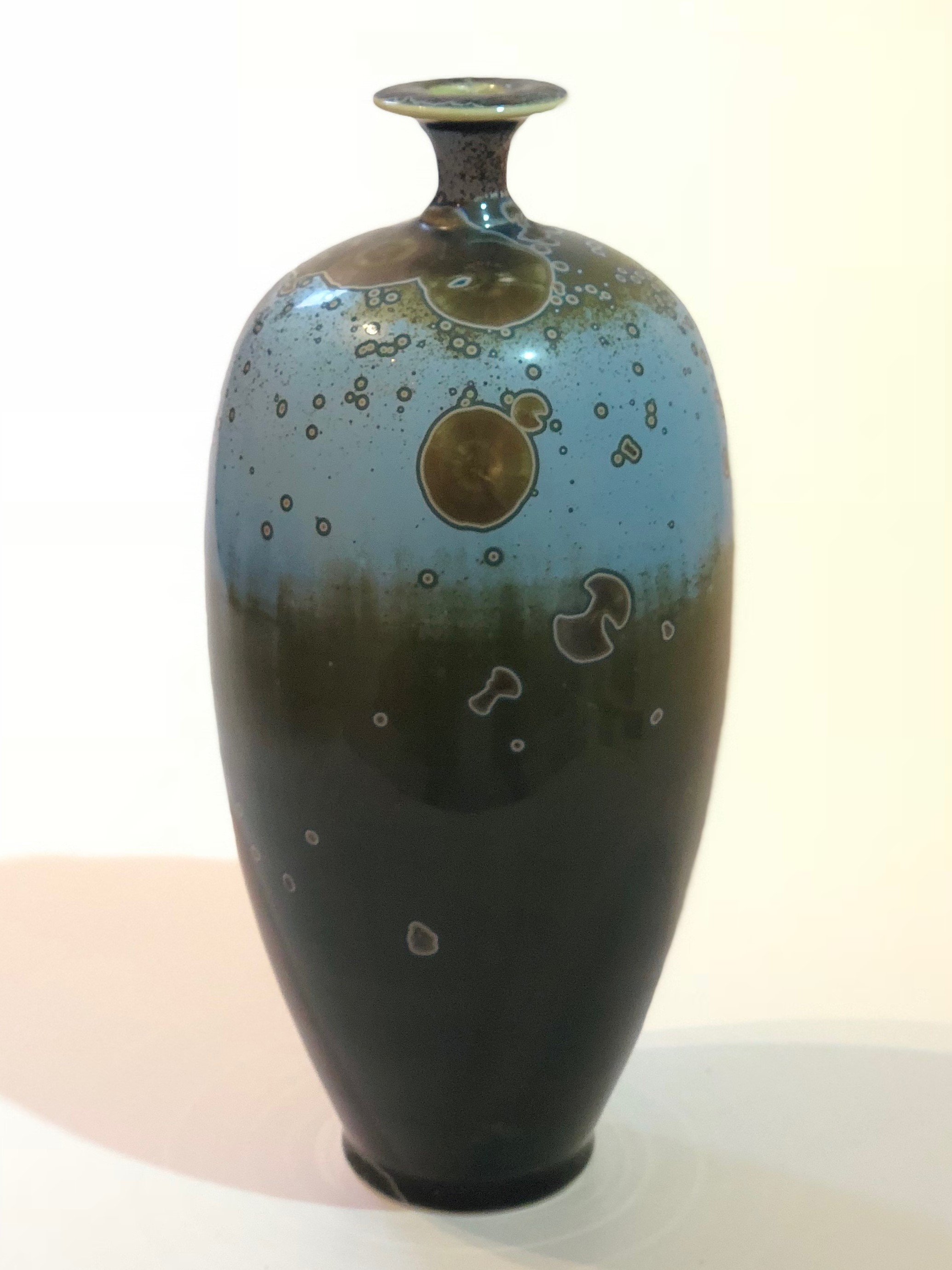Ted Secombe 50.  Bottle , 2018, porcelain, galaxy blue crystalline glaze with white, H26 x W17cm