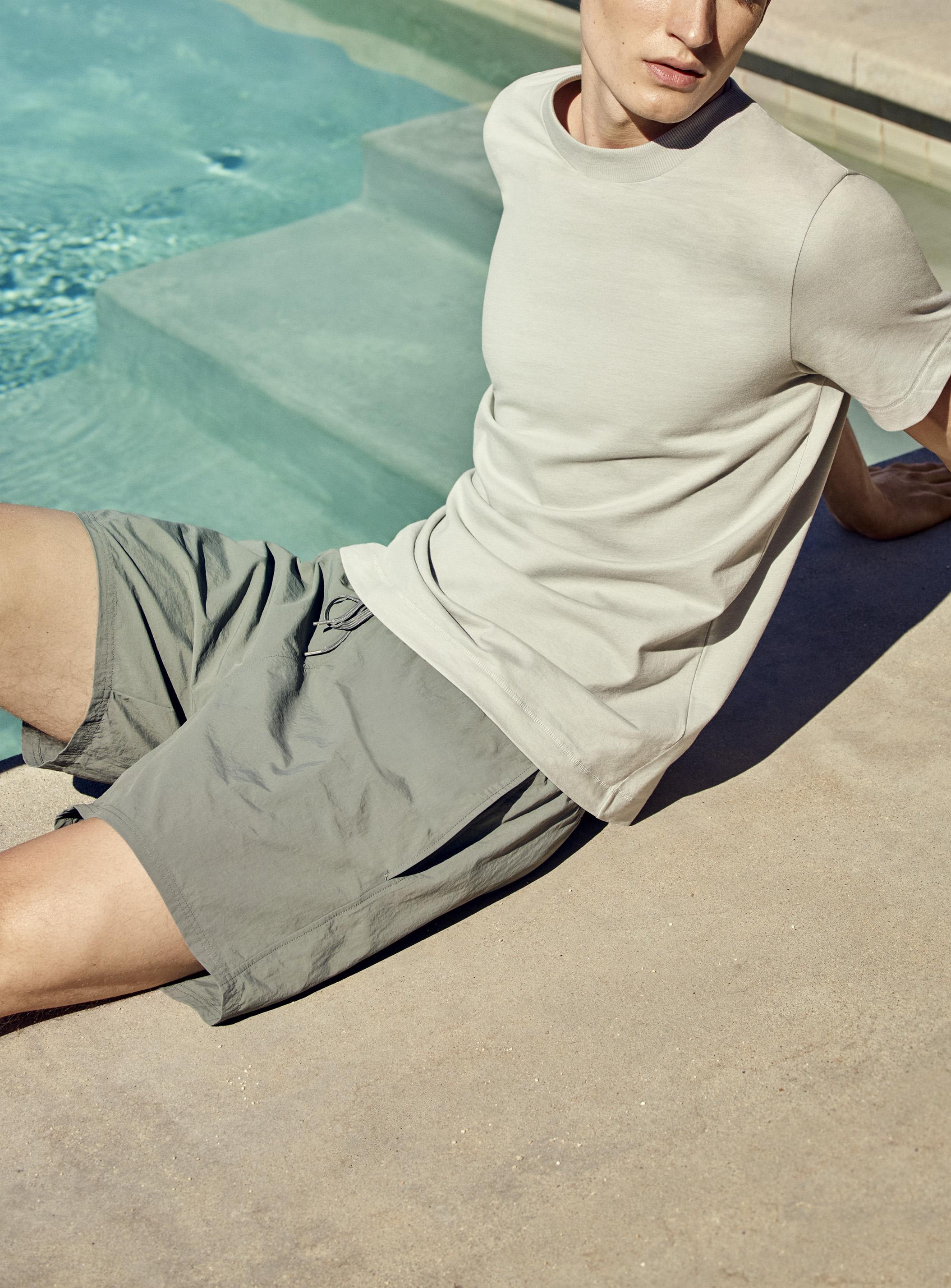 T-shirt with rib neck (19€) + Lightweight swim shorts (45€)