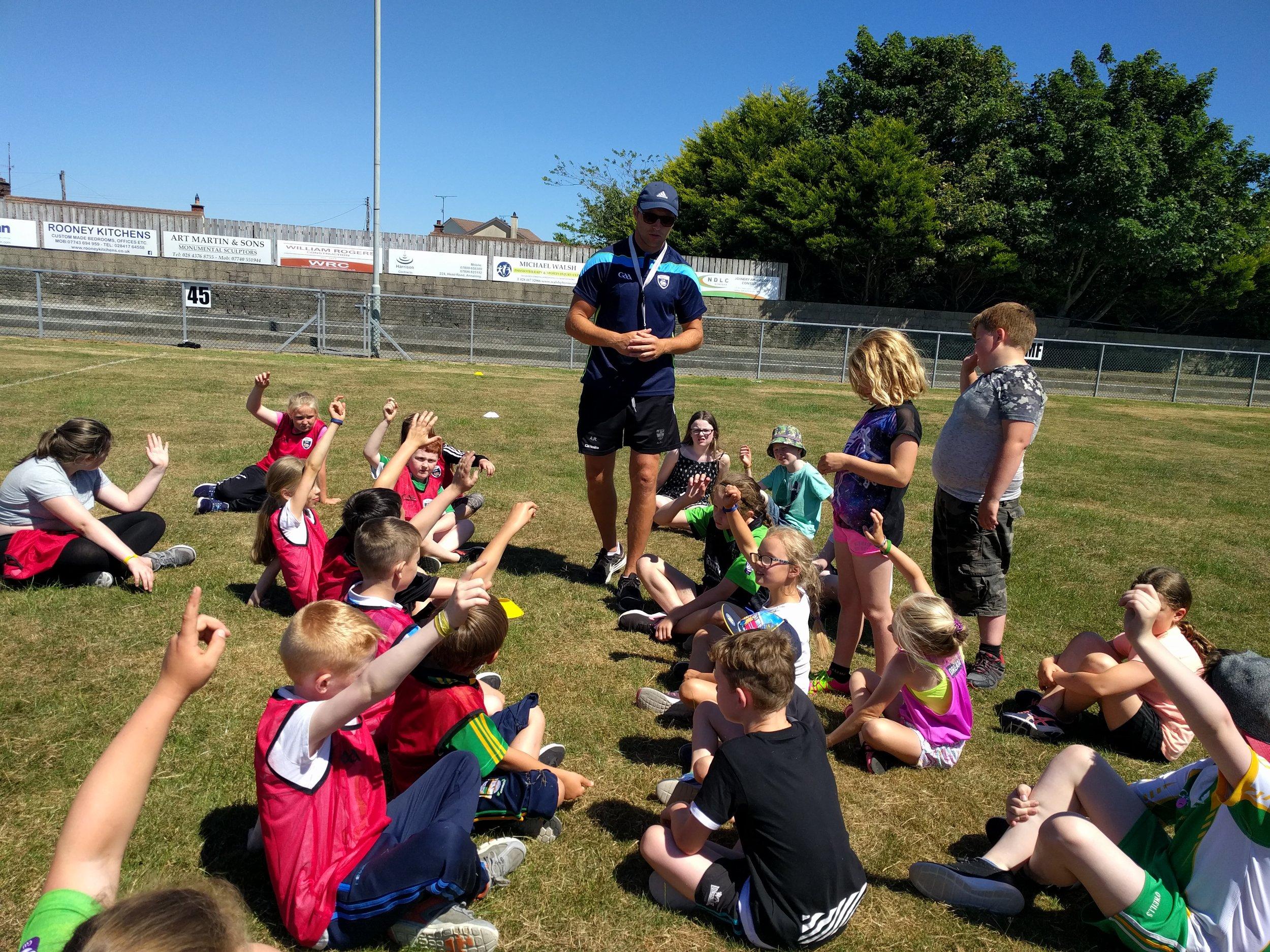 Down GAA Coach Ambrose Rodgers coaching the children at Scoil Samhraidh.jpg