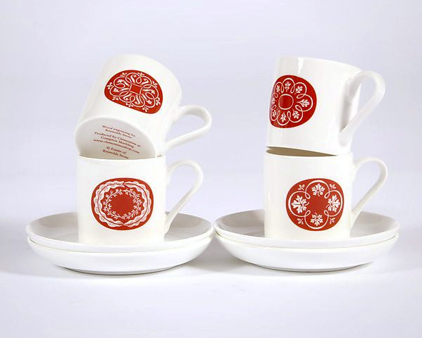 The cups are printed in the UK. Size cup 6cm high, saucer 12cm