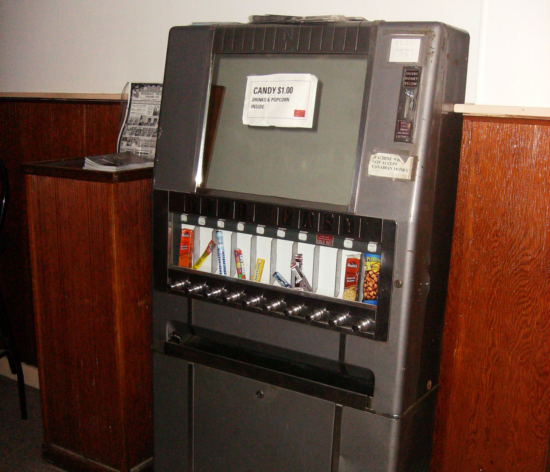 An old vending machine that dispenses candy, in the Rosendale Theatre lobby. Source:  Wikicommons