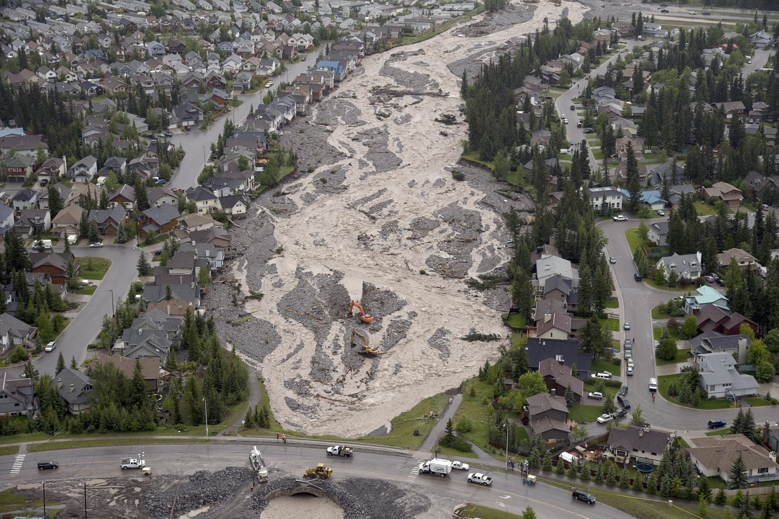 Figure 2.  Cougar Creek following June 2013 flood event. (Photo credit: The Canadian Press, Jonathan Hayward)