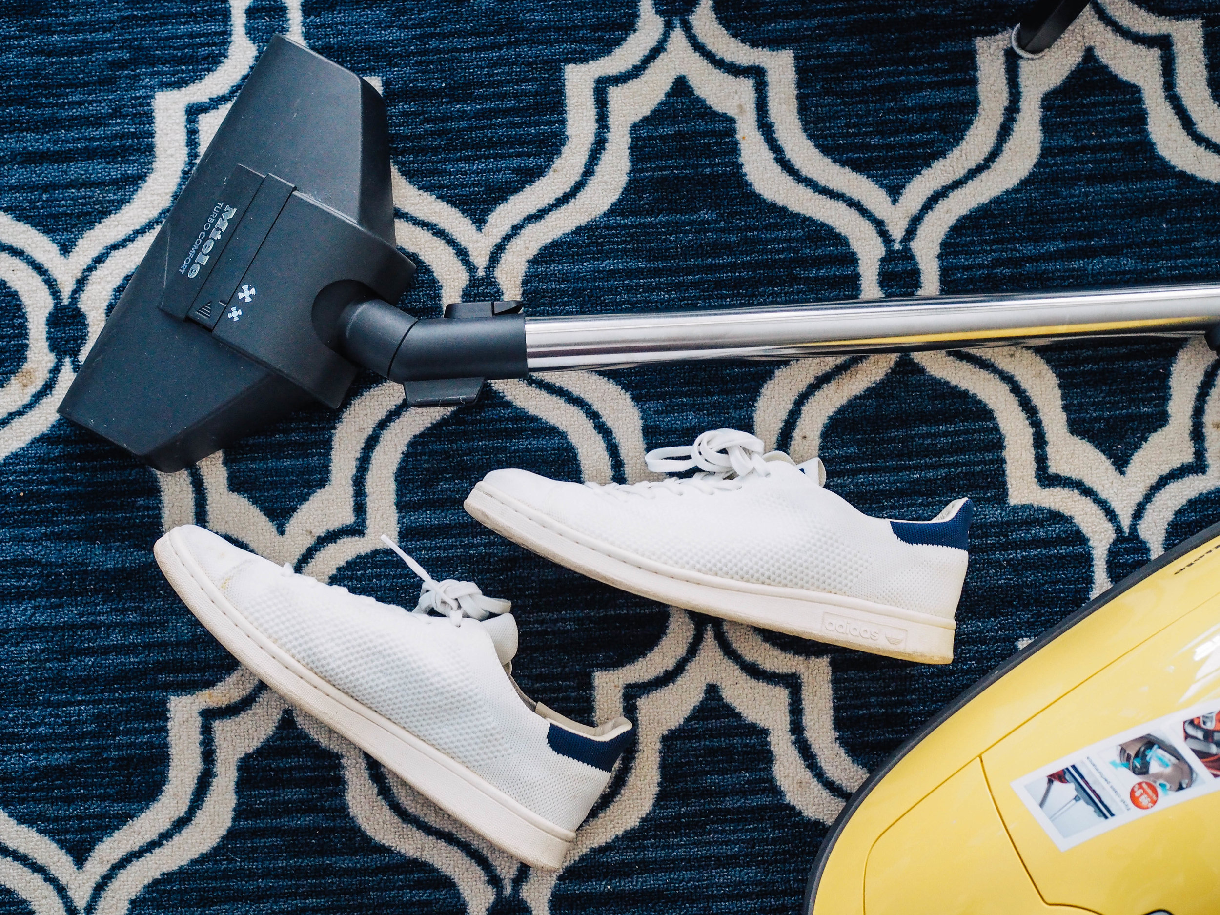 rugs with shoes and vacuum