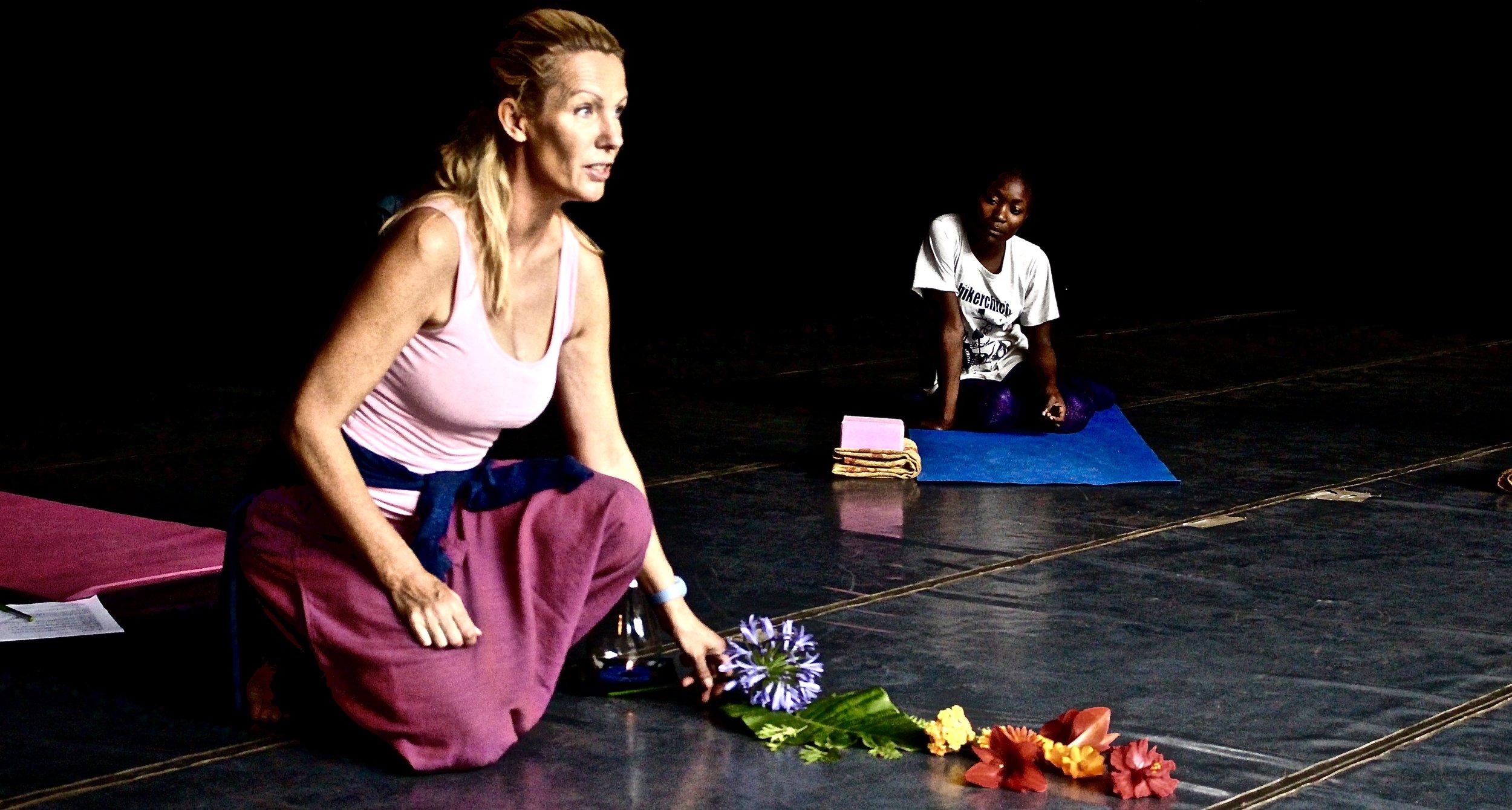 "Marion teaching onstage""Chakras through flowers"""