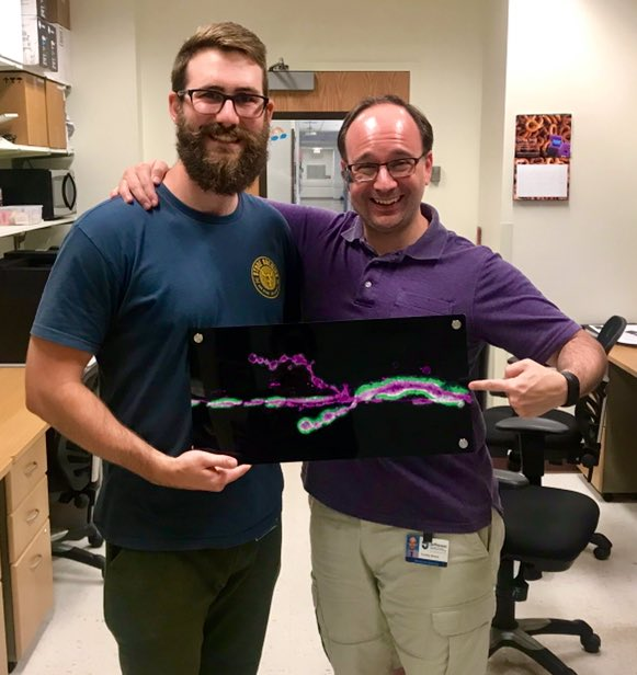 Lucas and Tim with Lucas' goodbye gift from the lab - a metal print of his first major result!