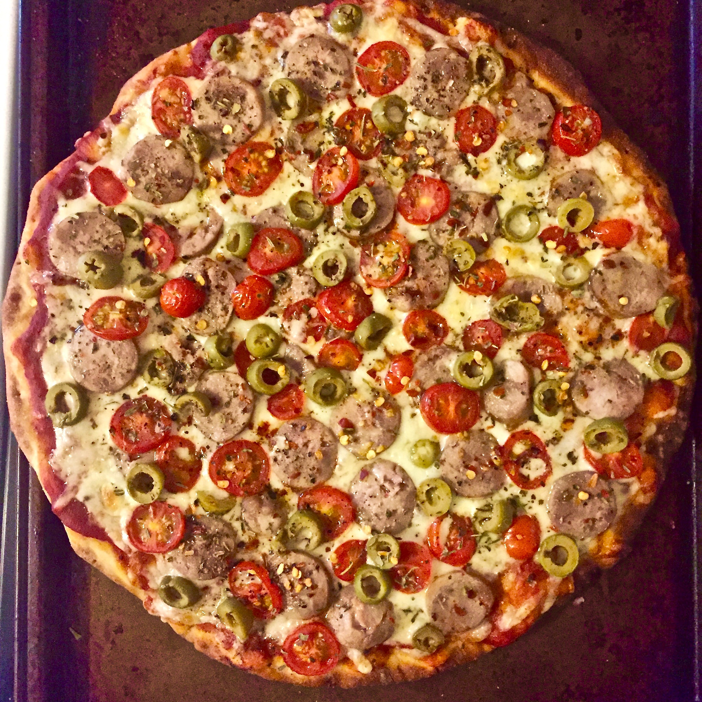 Italian sausage, green olives, grape tomatoes, and a   proprietary blend of herbs and seasoning