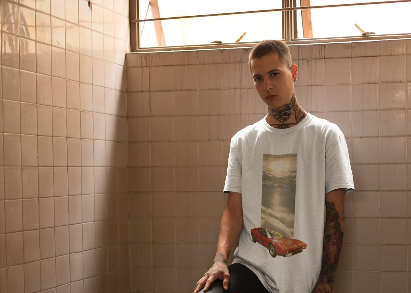 t-shirt-mockup-of-a-punk-man-with-tattoos-leaning-against-a-tiles-wall-23461 copy.png