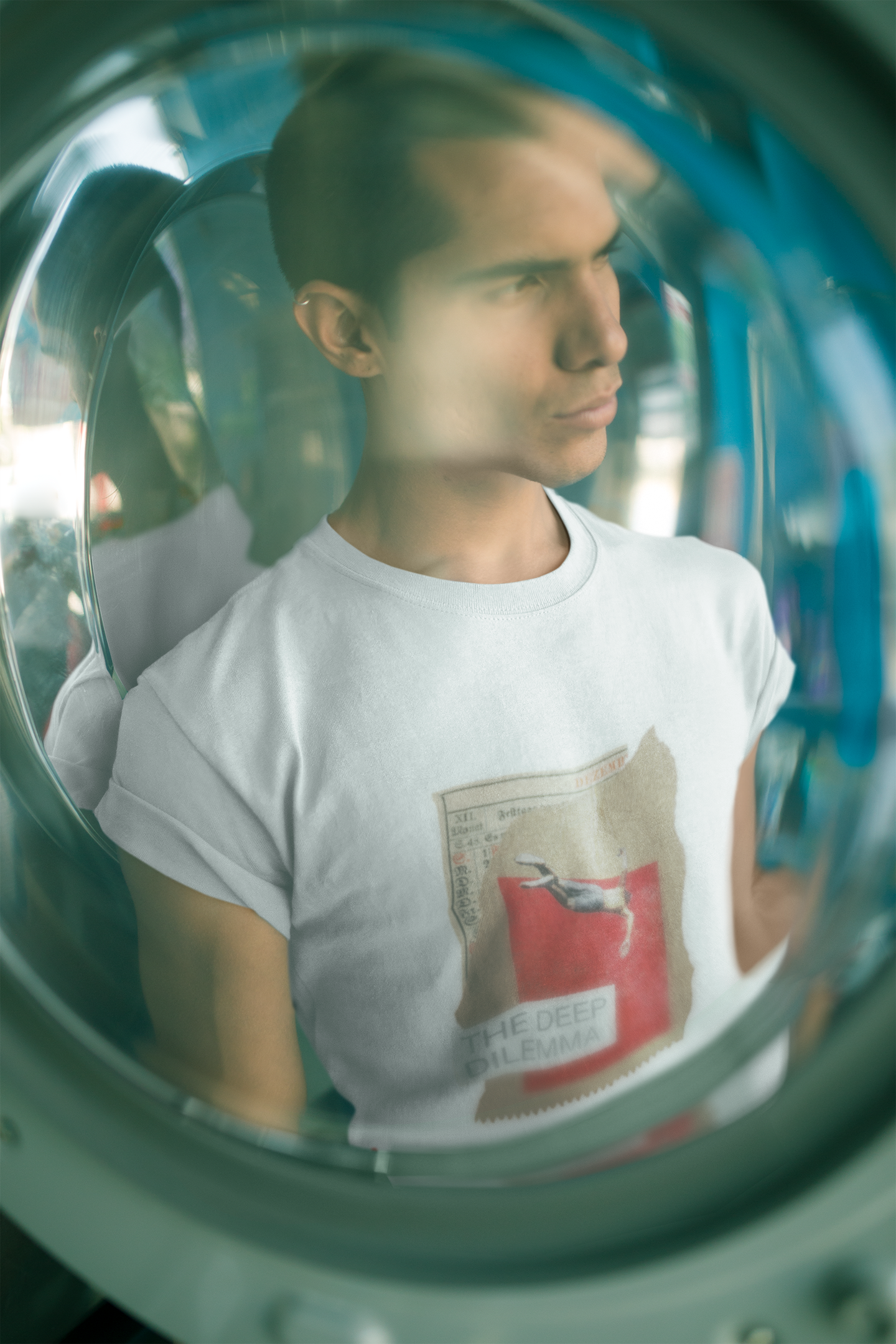 through-a-glass-mockup-of-a-man-wearing-a-t-shirt-at-a-laundry-a19700 (1).png