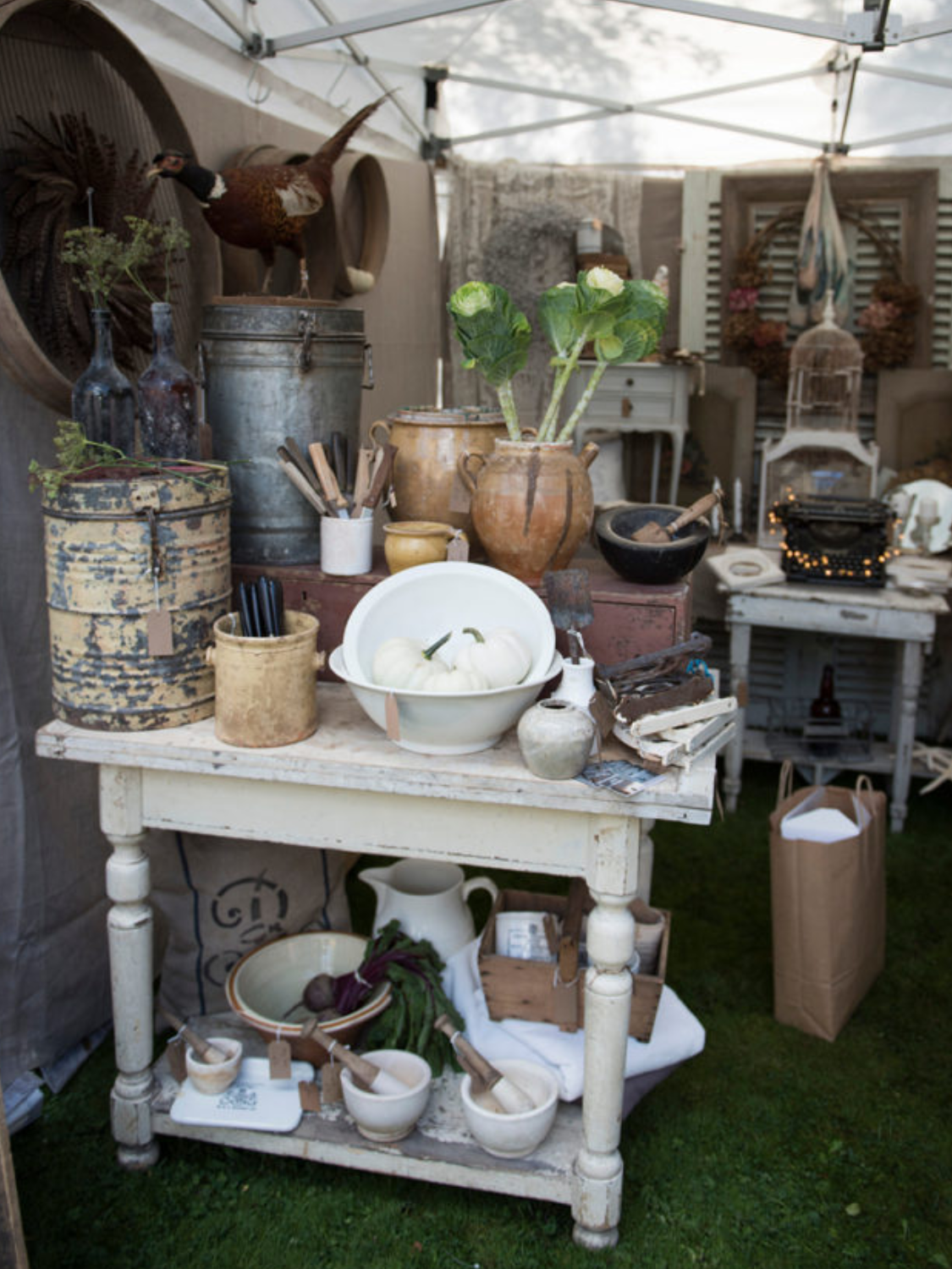 The gorgeous stall of  Weathered & Worn  safely under a gazebo