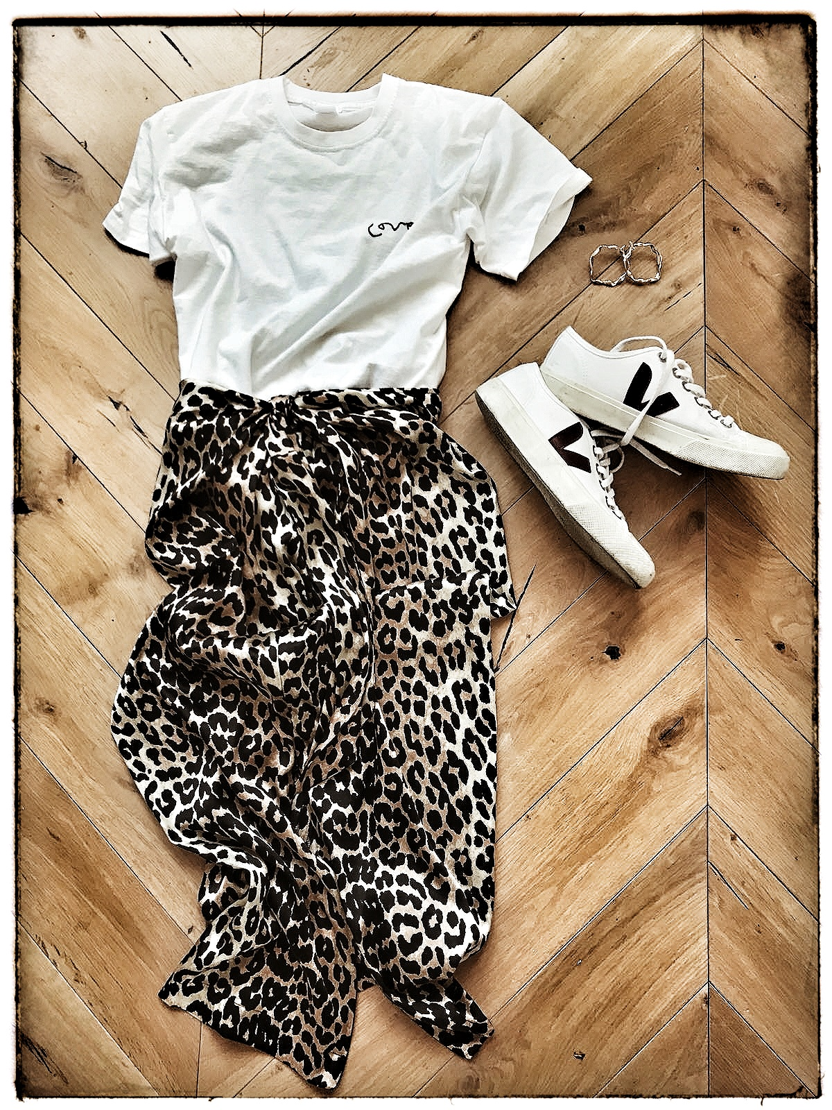 T-Short from  Meylor Goods , Skirt from  Ganni  and trainers from  Veja