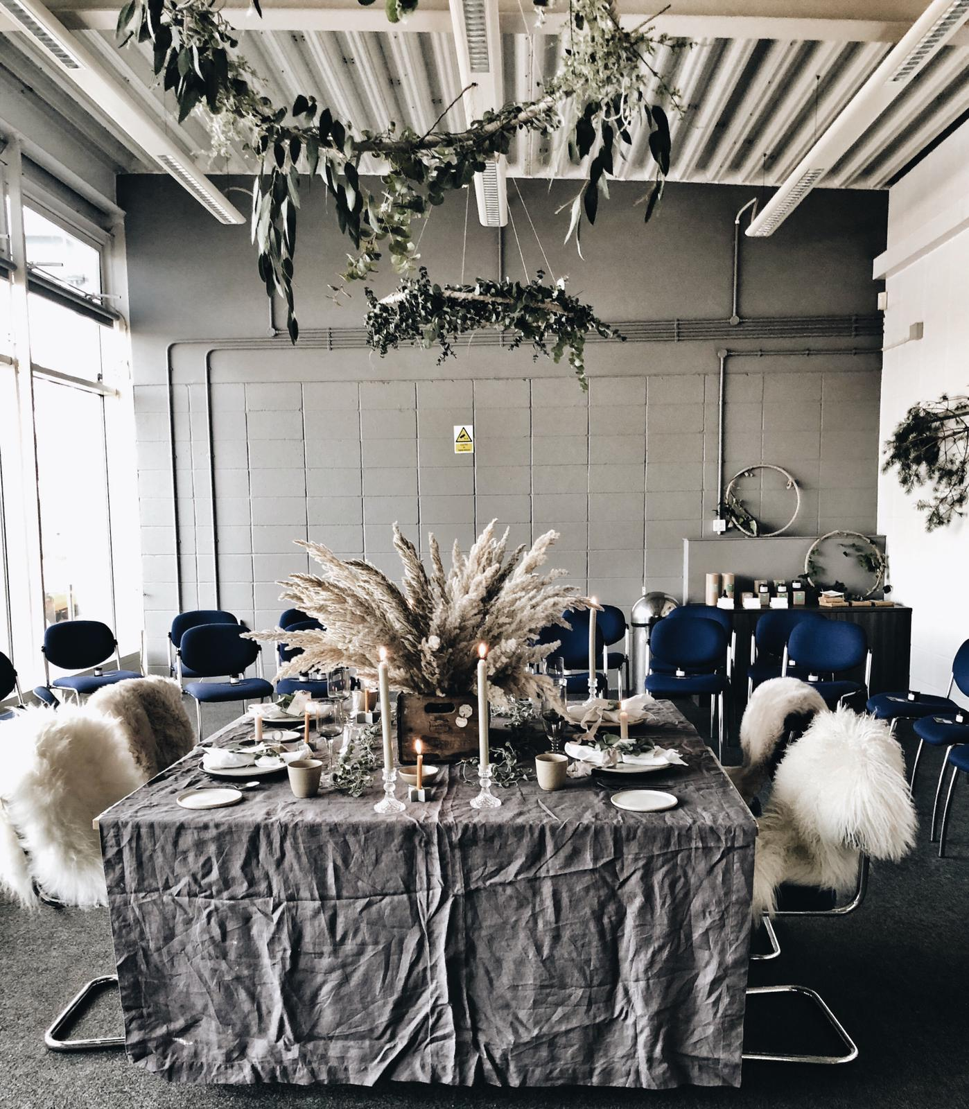 We were working with quite a big space so went for a dramatic table centre piece using pampas grass and made the table cosier by adding sheepskins to our chairs from Jord Home