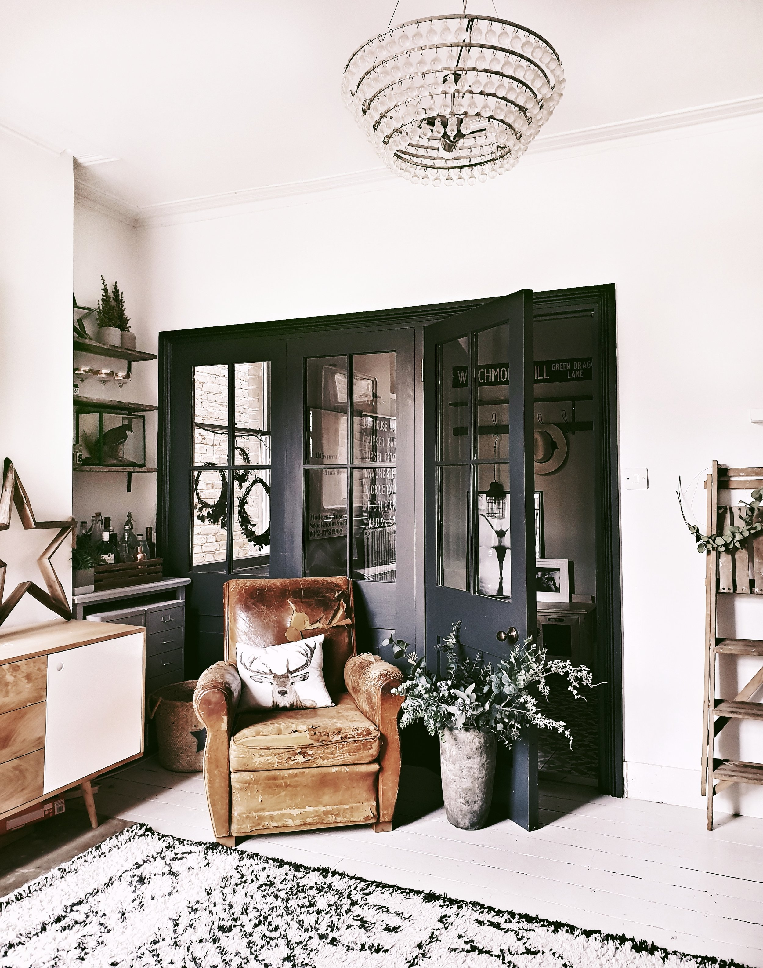 This side of the room often pops up on Instagram as it features one of my favourite additions to the house: these faux crittal doors