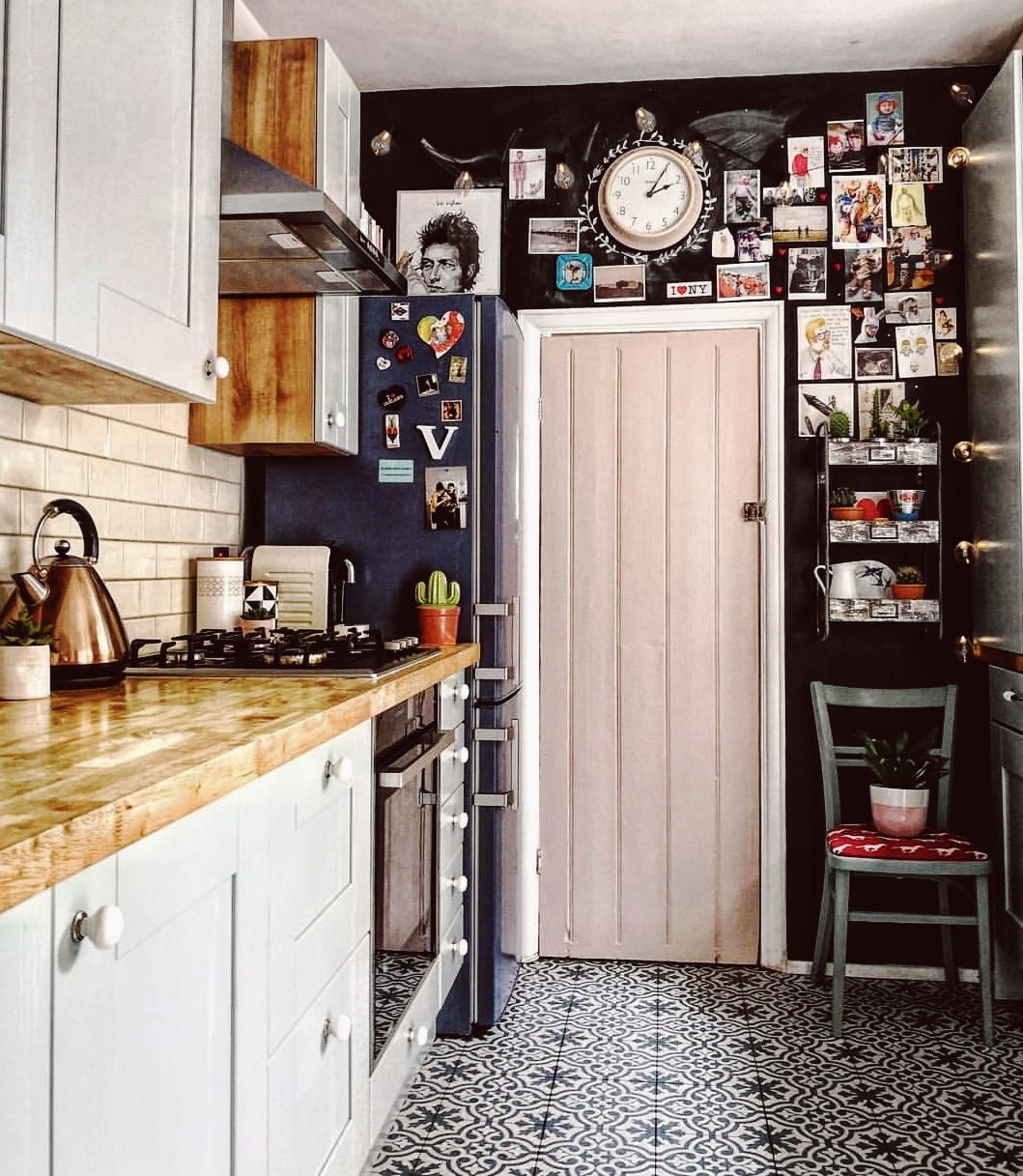 Kitchen with chalkboard wall and pink door