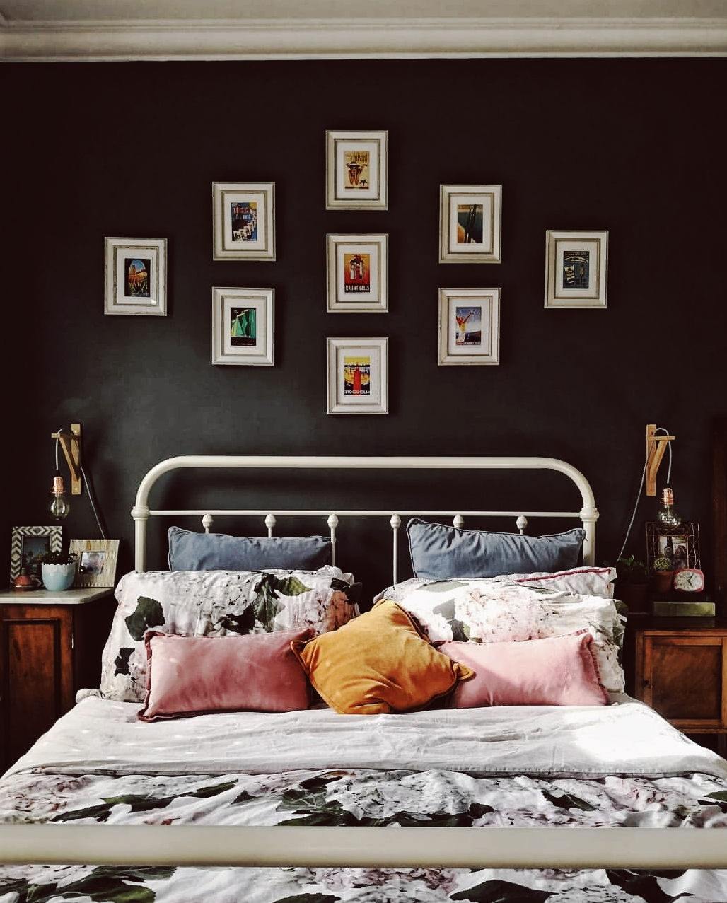 I love how she has painted the walls dark in her bedroom and then uses her bedding to bring the colour in