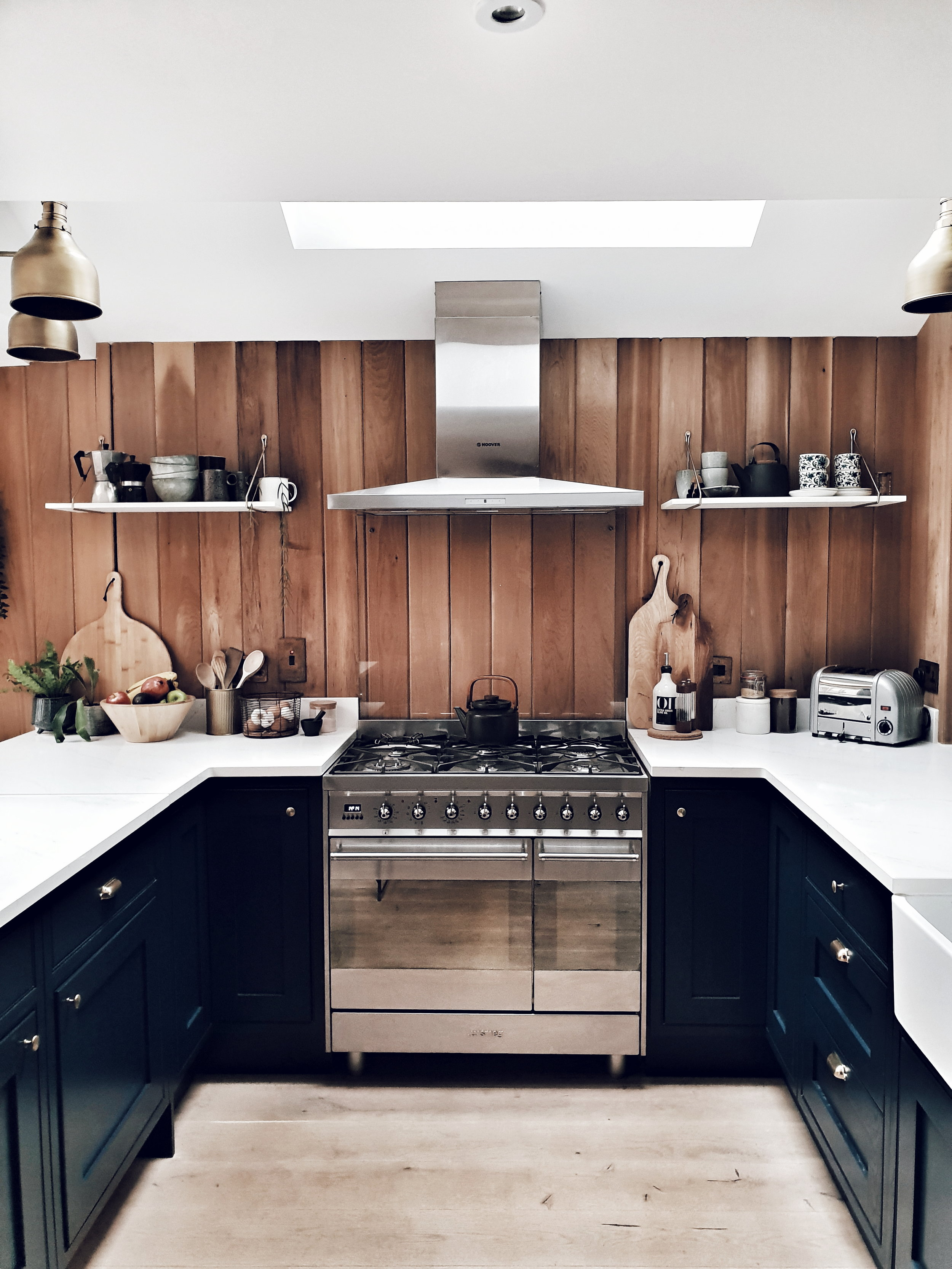 The kitchen that made me click follow on Maz's Instagram account  @the_ wooden _hill  with its stunning navy cabinets, brass handles and timber clad walls