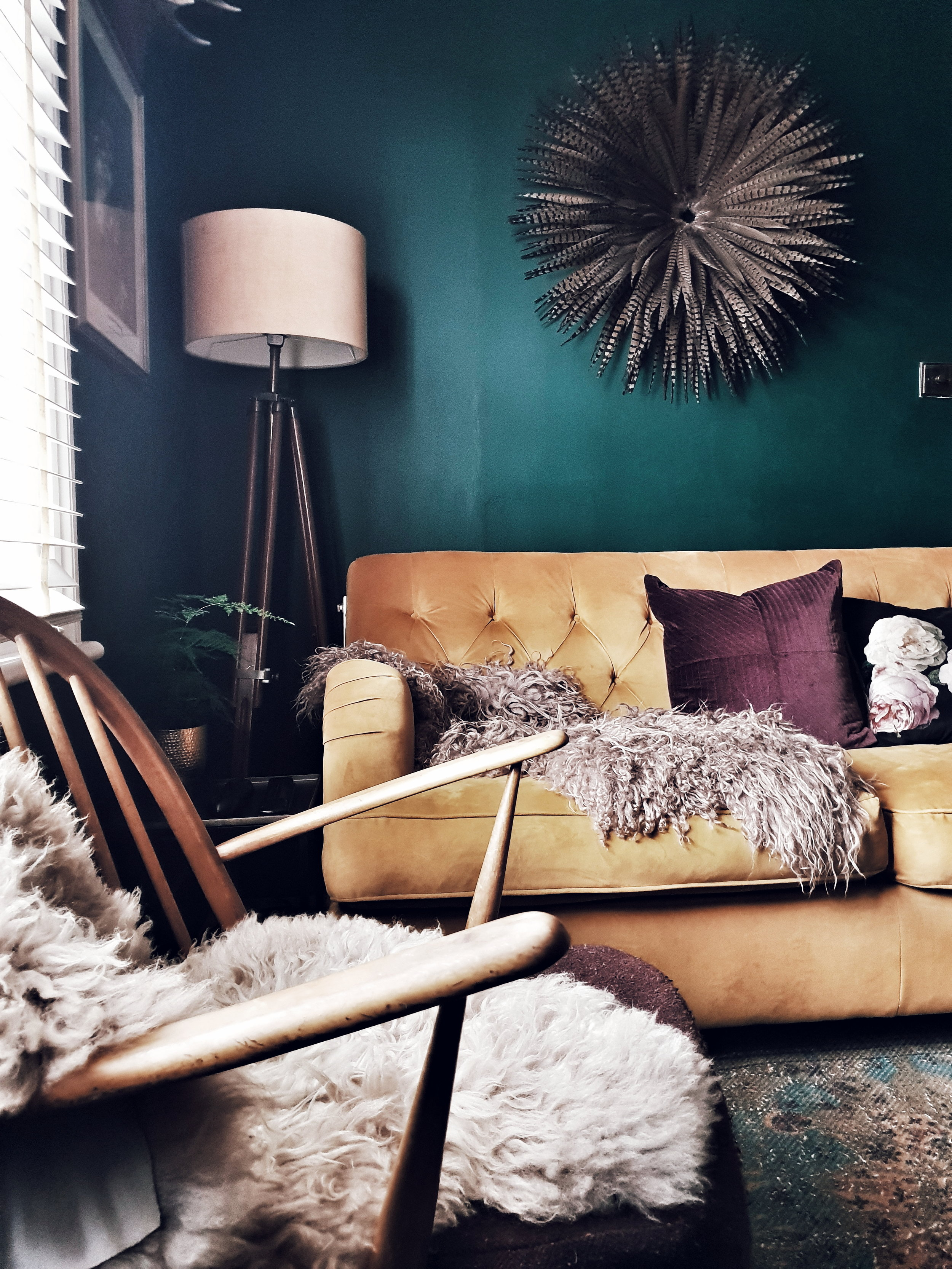 The front room is a gorgeous cosy space with a snug feel created by the use of warm jewel colours and lots of texture