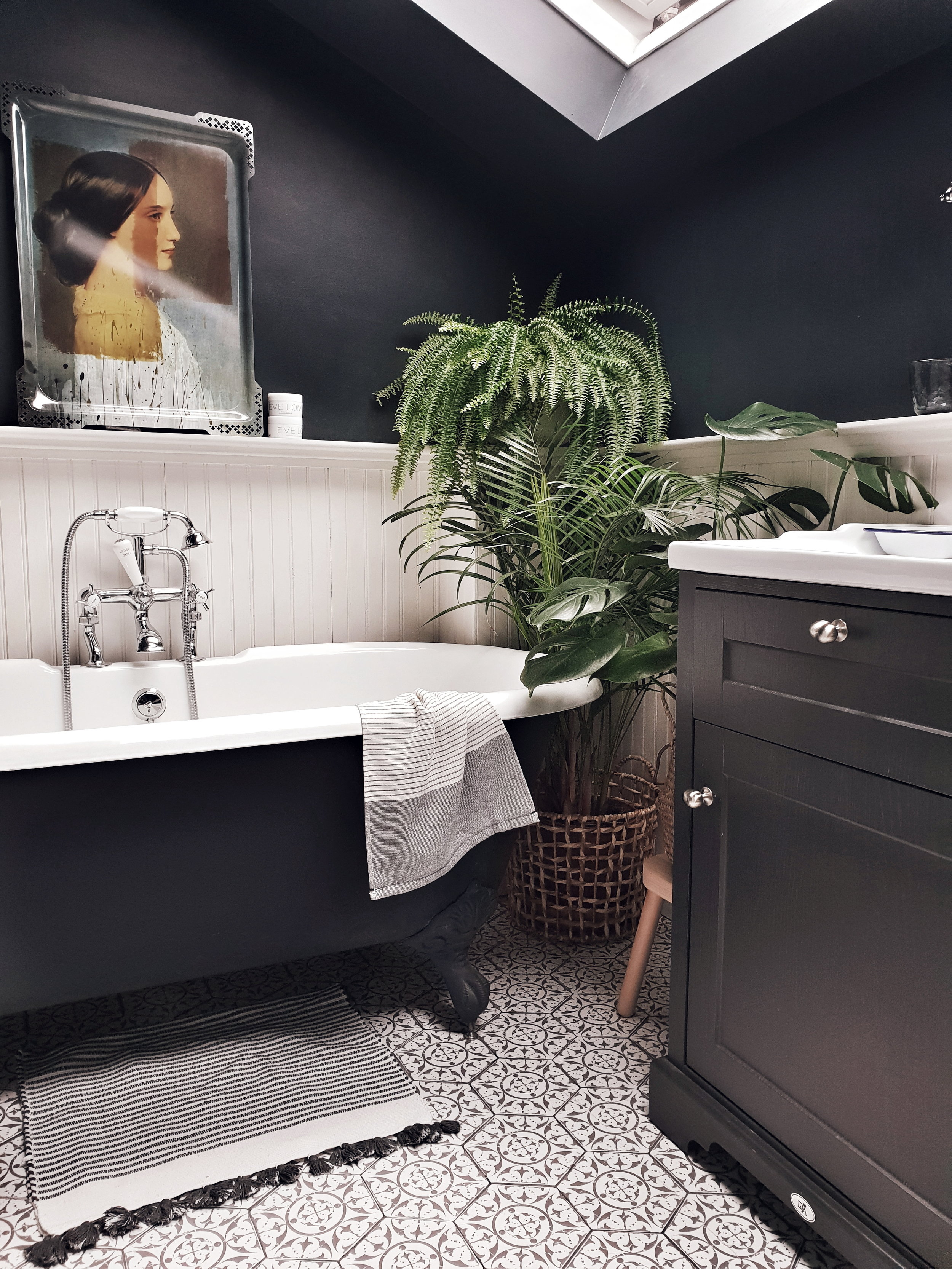 The couple sacrificed a third bedroom to move the bathroom upstairs and fit this stunning roll top bath in