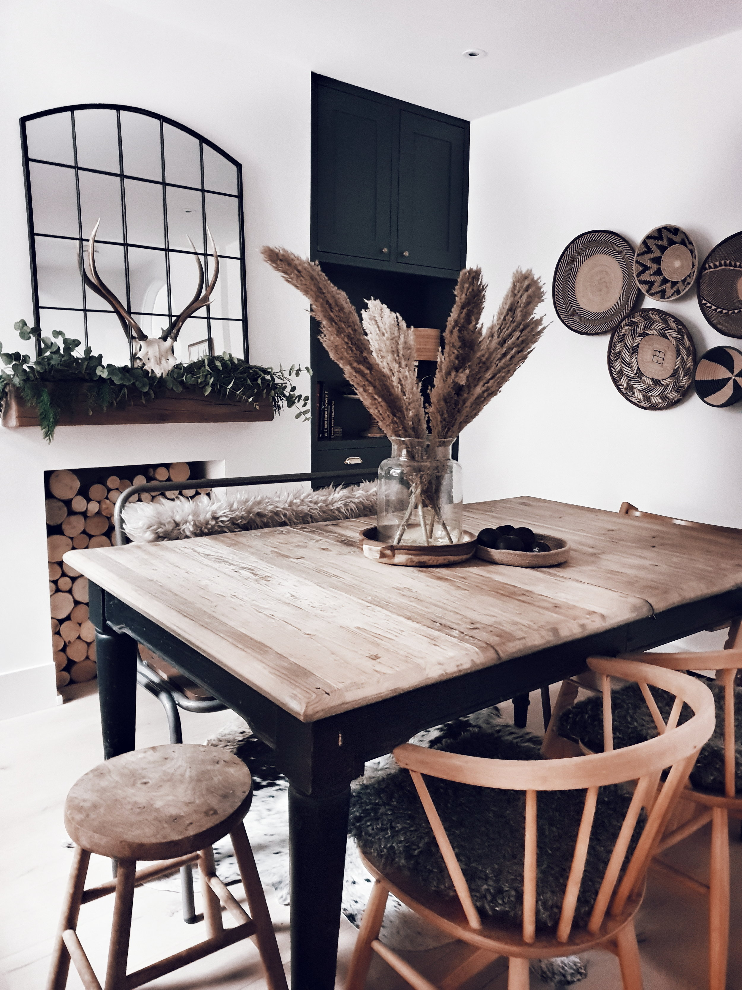 The family dining space with hygge sheepskins on the chairs