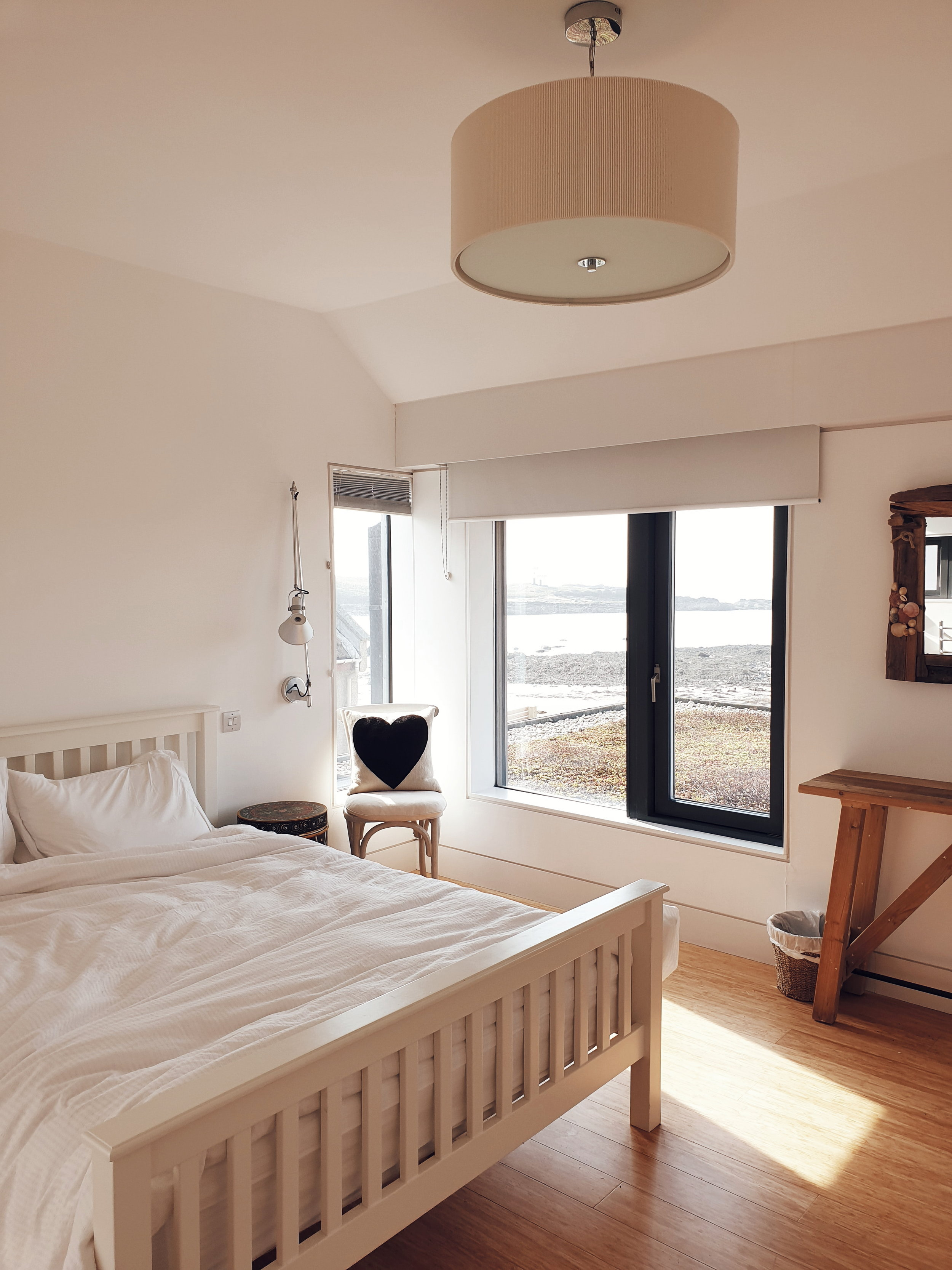 One of the bedrooms with views of a lighthouse