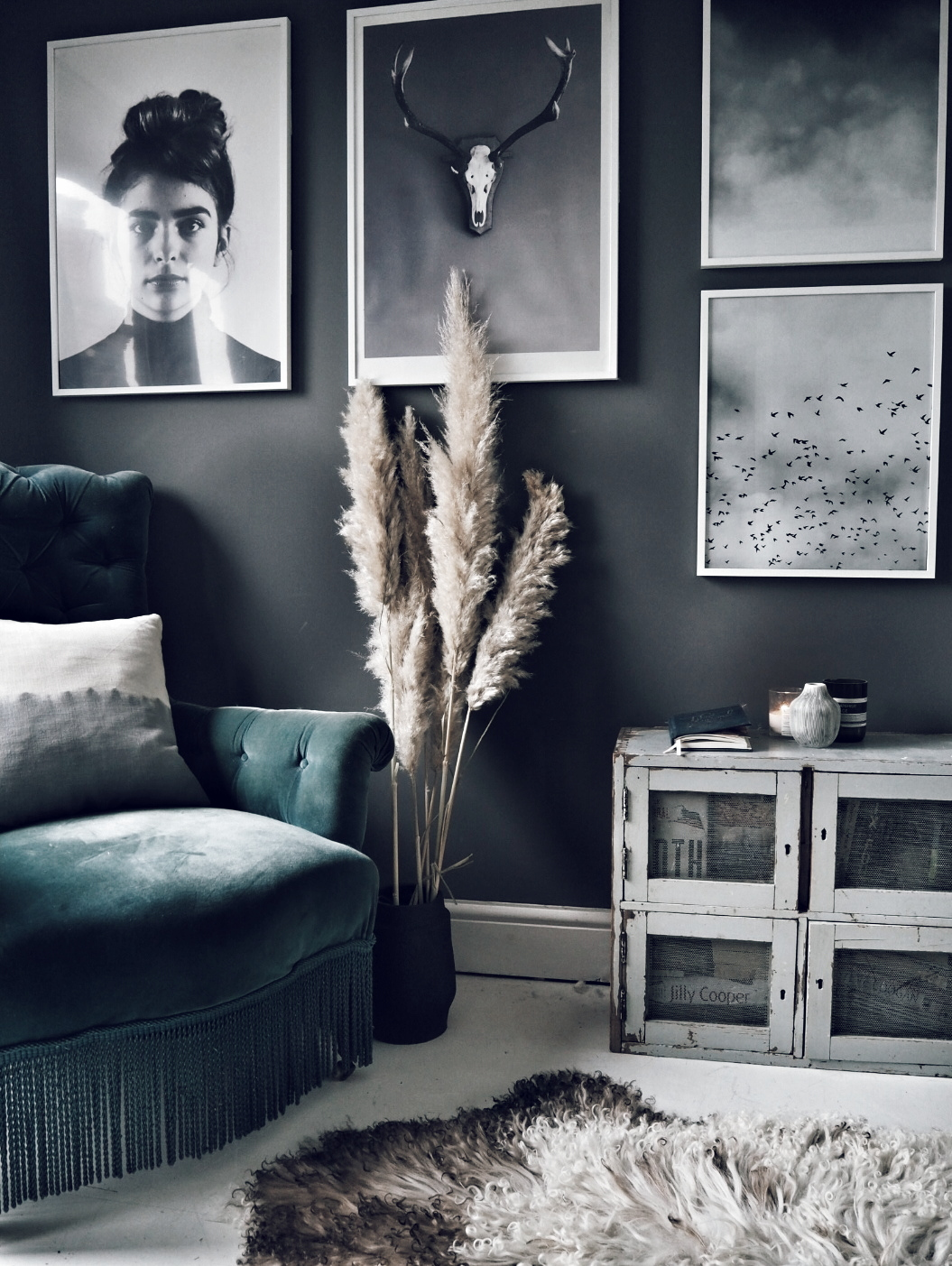 I added a monochrome gallery wall and armchair to this corner to create a separate sitting area within the room