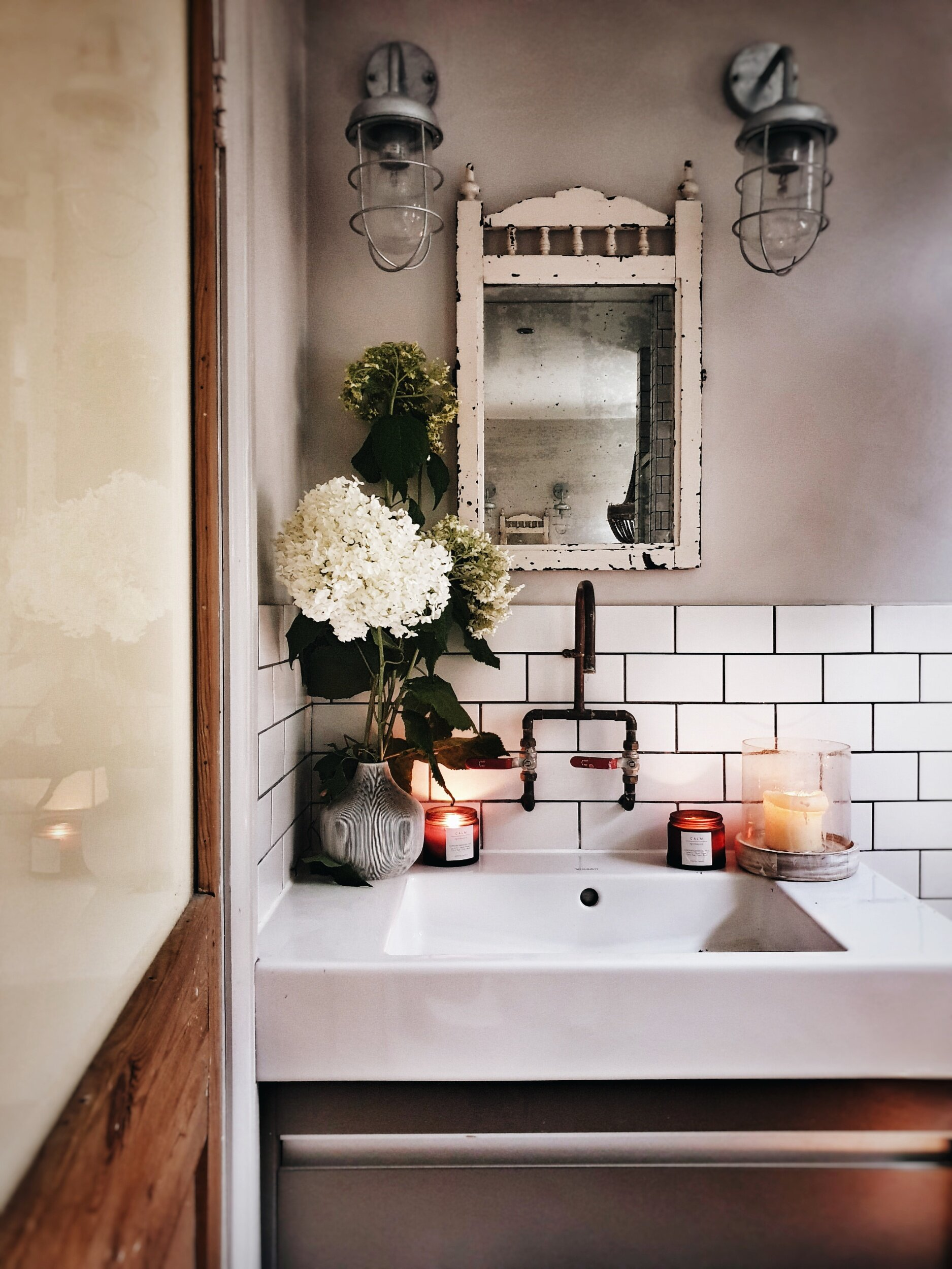 The copper taps made by my builder added an industrial edge to the bathroom that I loved