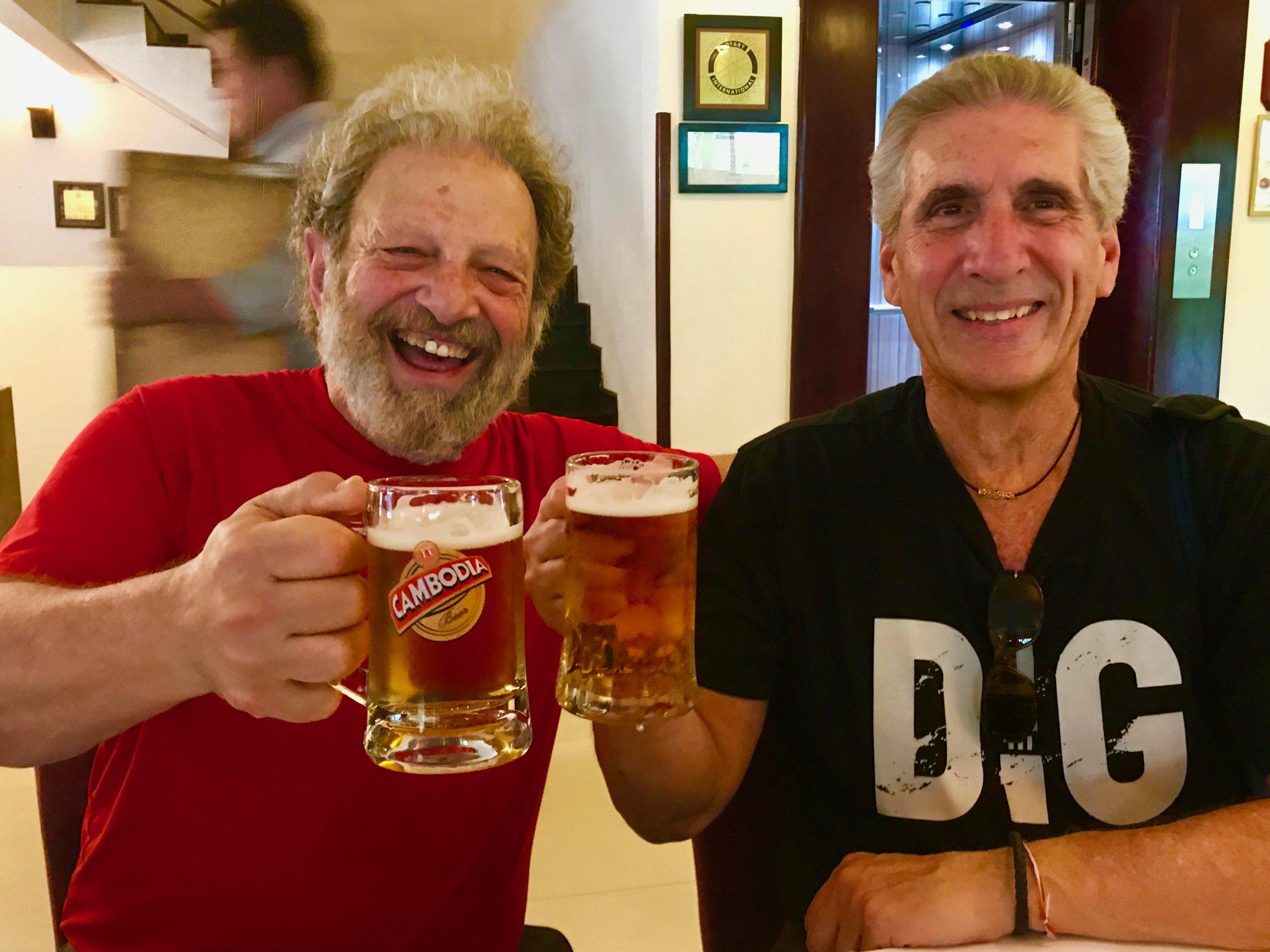Jerry & Me Toasting w beer mug Cambodia.jpg