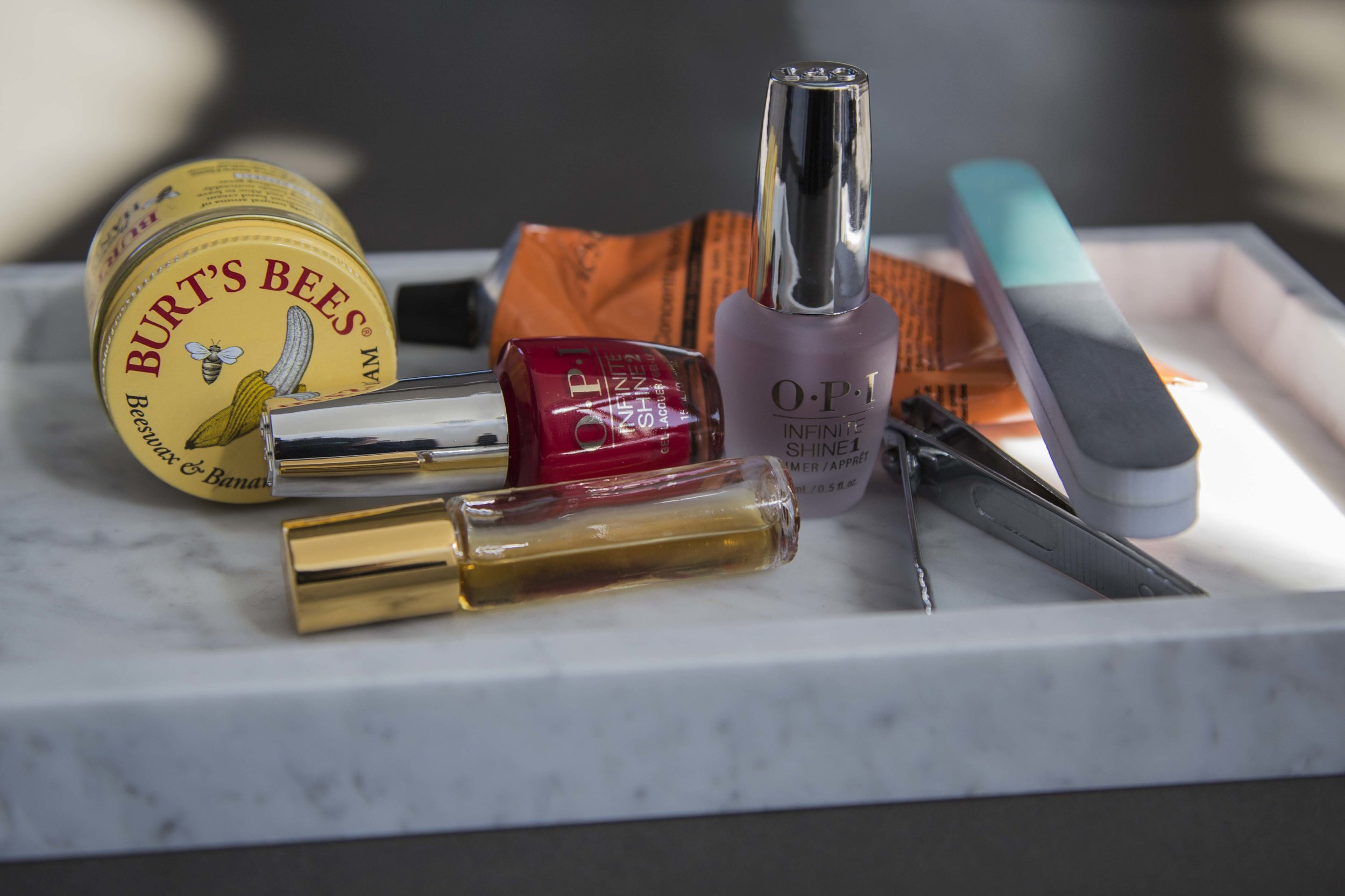Taking Care of Your Nails When You Have a Nail Polish Obsession:Burt's Bees Beeswax & Banana Hand Cream, Cuticle Oil, OPI Infinite Shine, Aesop Body Lotion, Nail Clippers and Buffer