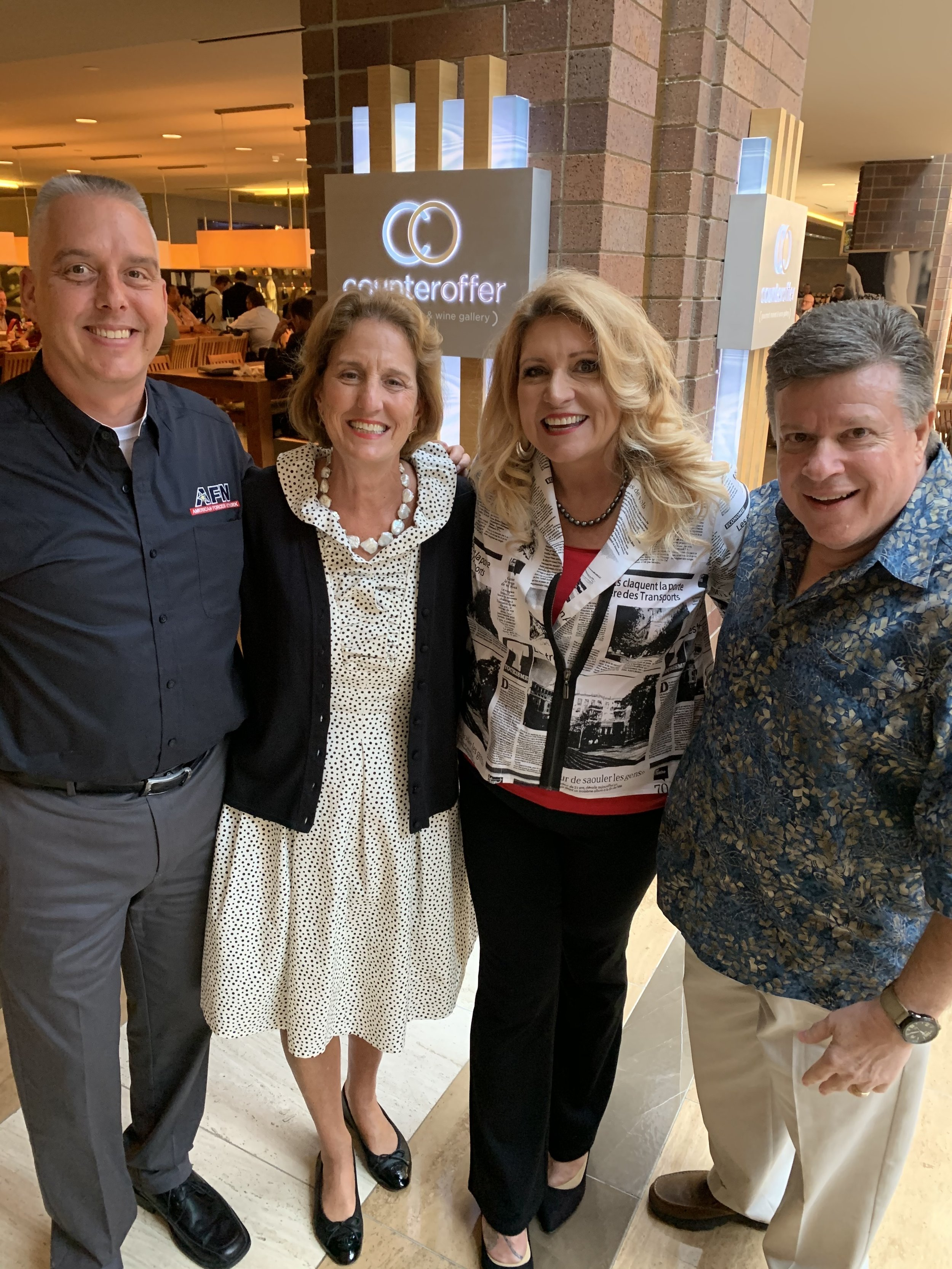 From L-R: Tom Arnholt (AFN Programming), Premiere Networks President Julie Talbott, Delilah and Curt Eckstein (AFN Operations) at the 2019 NAB Radio Show at Hilton Anatole Hotel in Dallas, Texas.